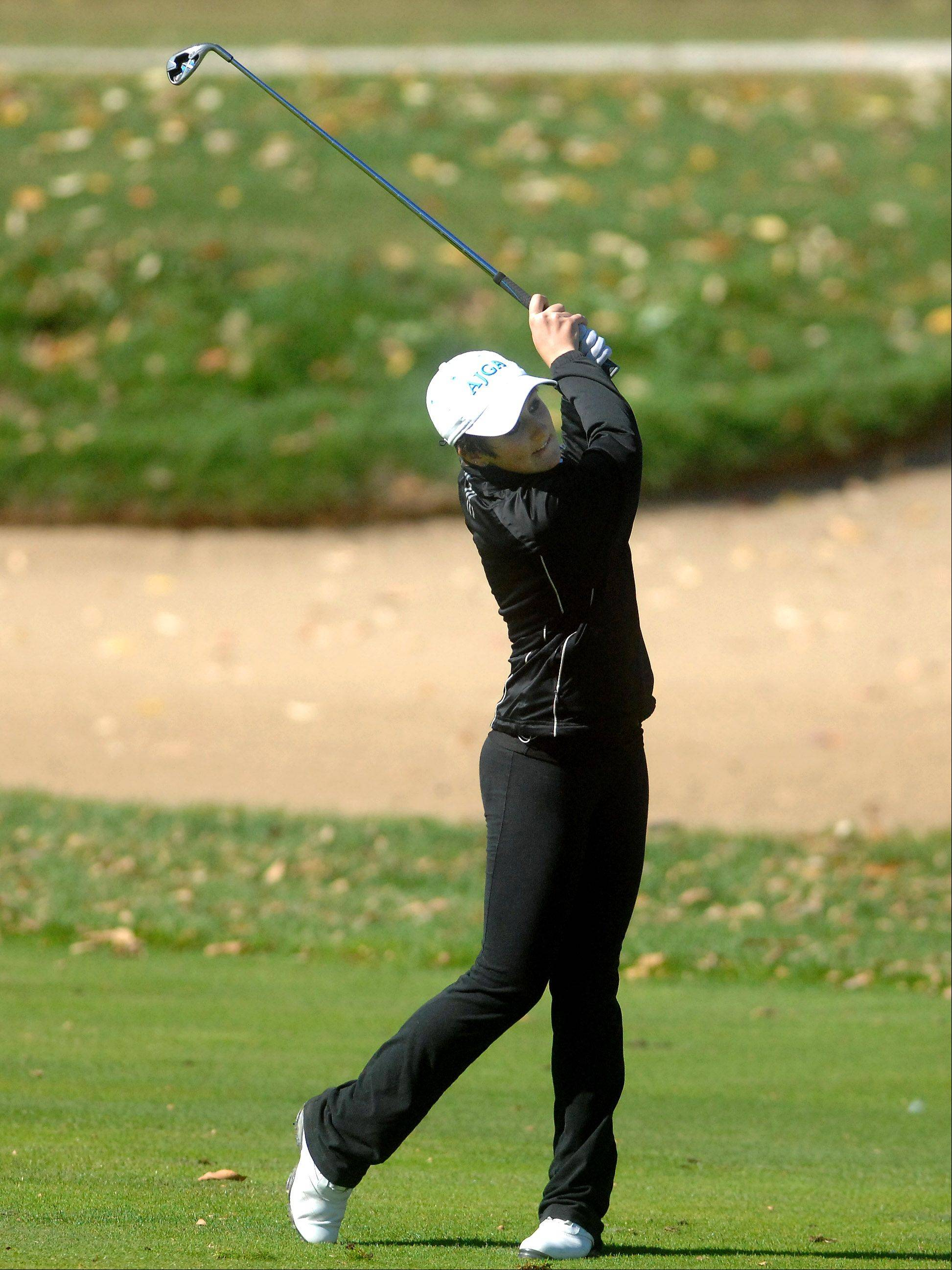 Ariana Furrie of St. Charles North hits from the 18th fairway during Monday's Burlington Central sectional girls golf action at Randall Oaks in West Dundee.