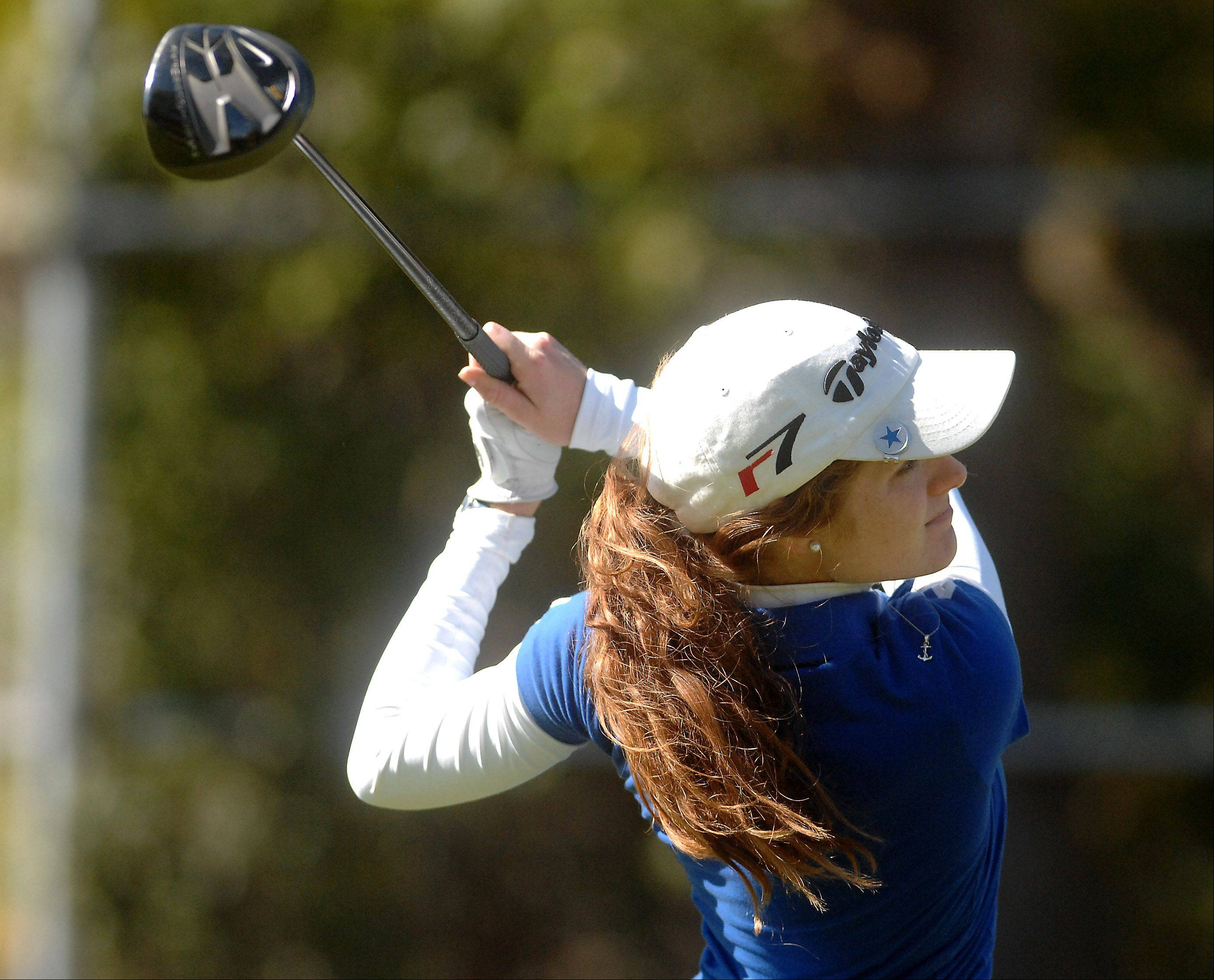 St. Charles North's Jessica Grill tees off on 18 during Monday's Burlington Central sectional girls golf action at Randall Oaks in West Dundee.