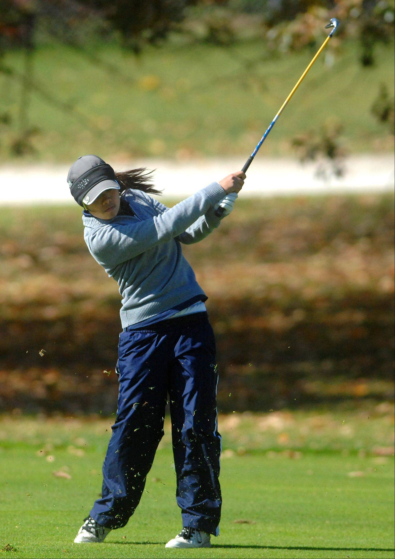 Hanna Netisingha of West Chicago hits from the 18th fairway during Monday's Burlington Central sectional girls golf action at Randall Oaks in West Dundee.