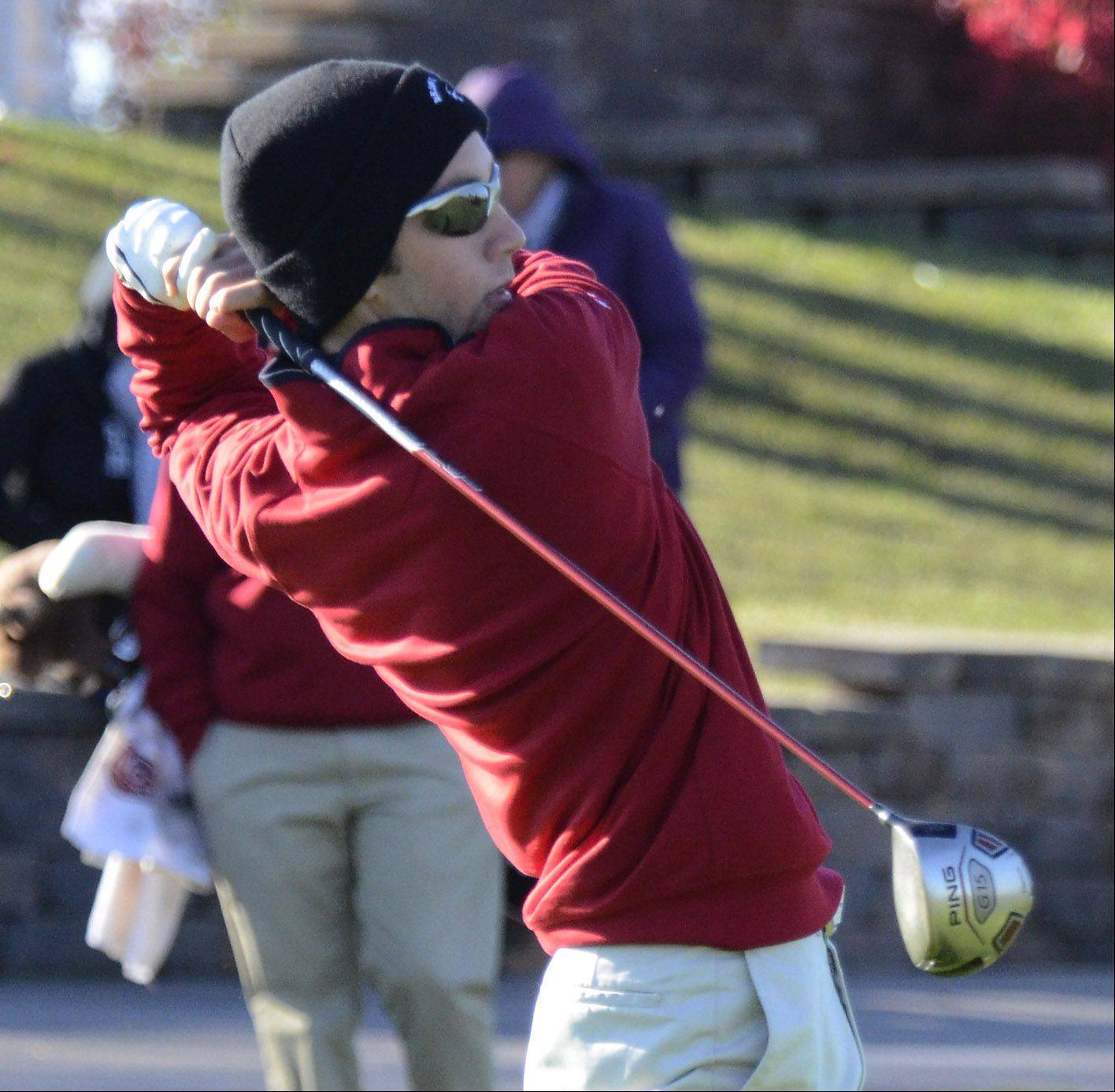 Barrington's Garrett Danelz drives at the 10th tee Monday at the Barrington sectional at Makray Memorial Golf Course.