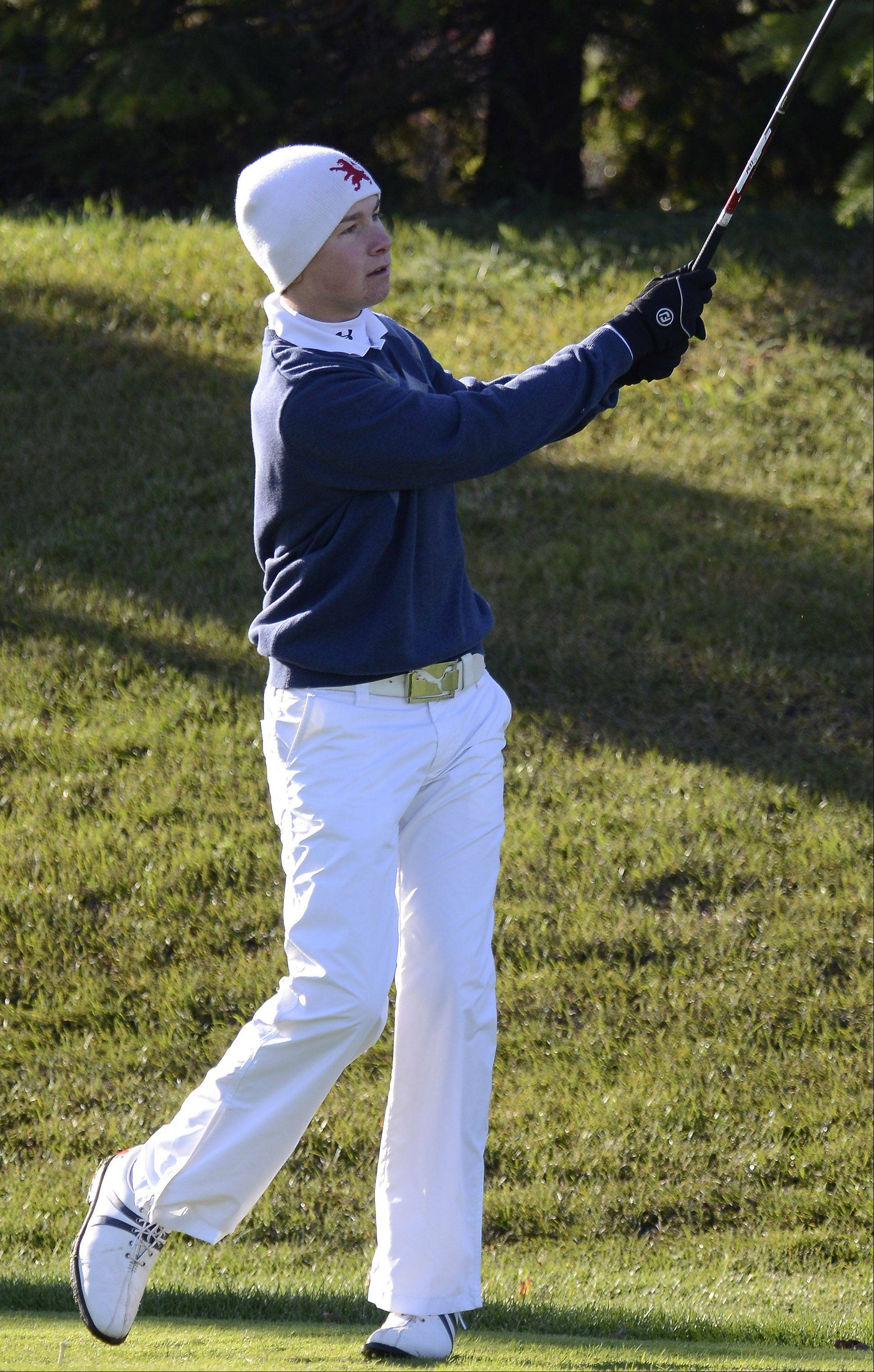 St. Viator's Nick Carlson follows his drive Monday at the Barrington sectional at Makray Memorial Golf Course.