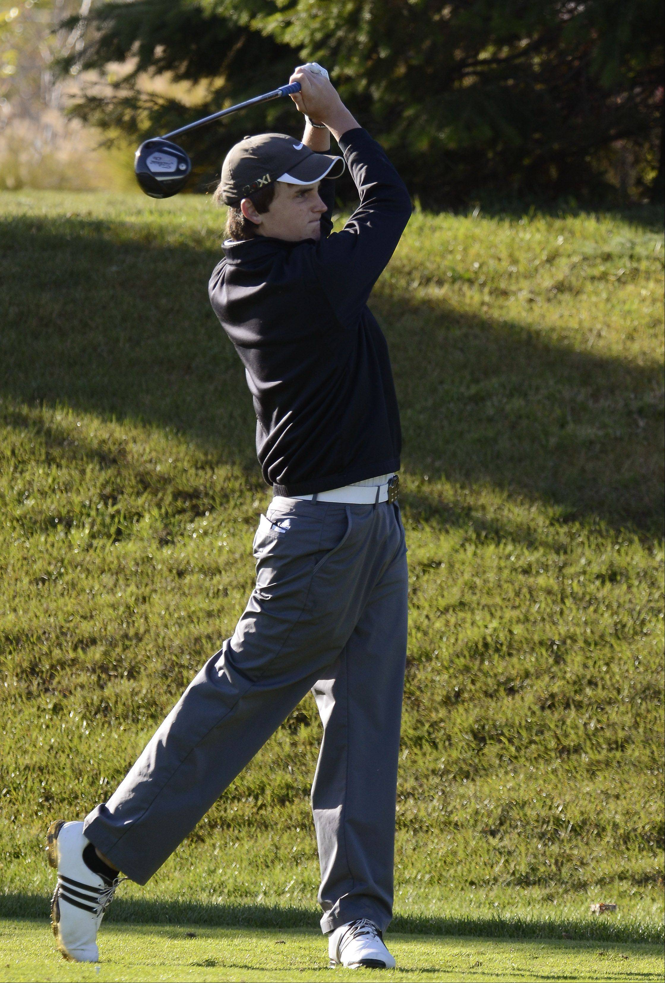 Carmel's David Thoensen drives Monday at the Barrington sectional at Makray Memorial Golf Course.
