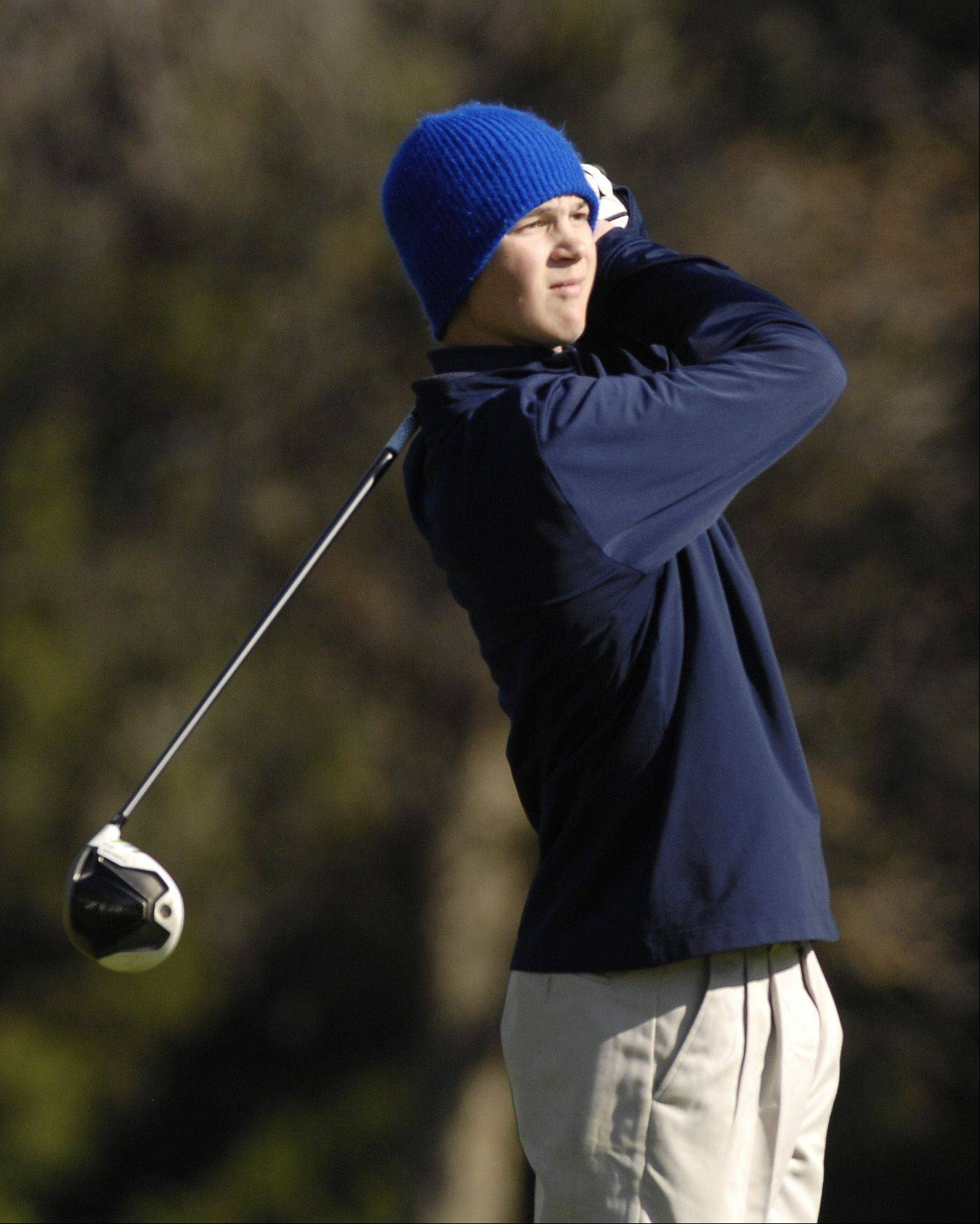 Dan Harnett of Addison Trail tees off during the St. Charles East boys varsity golf sectional at St. Andrews Golf Club in West Chicago, Monday.
