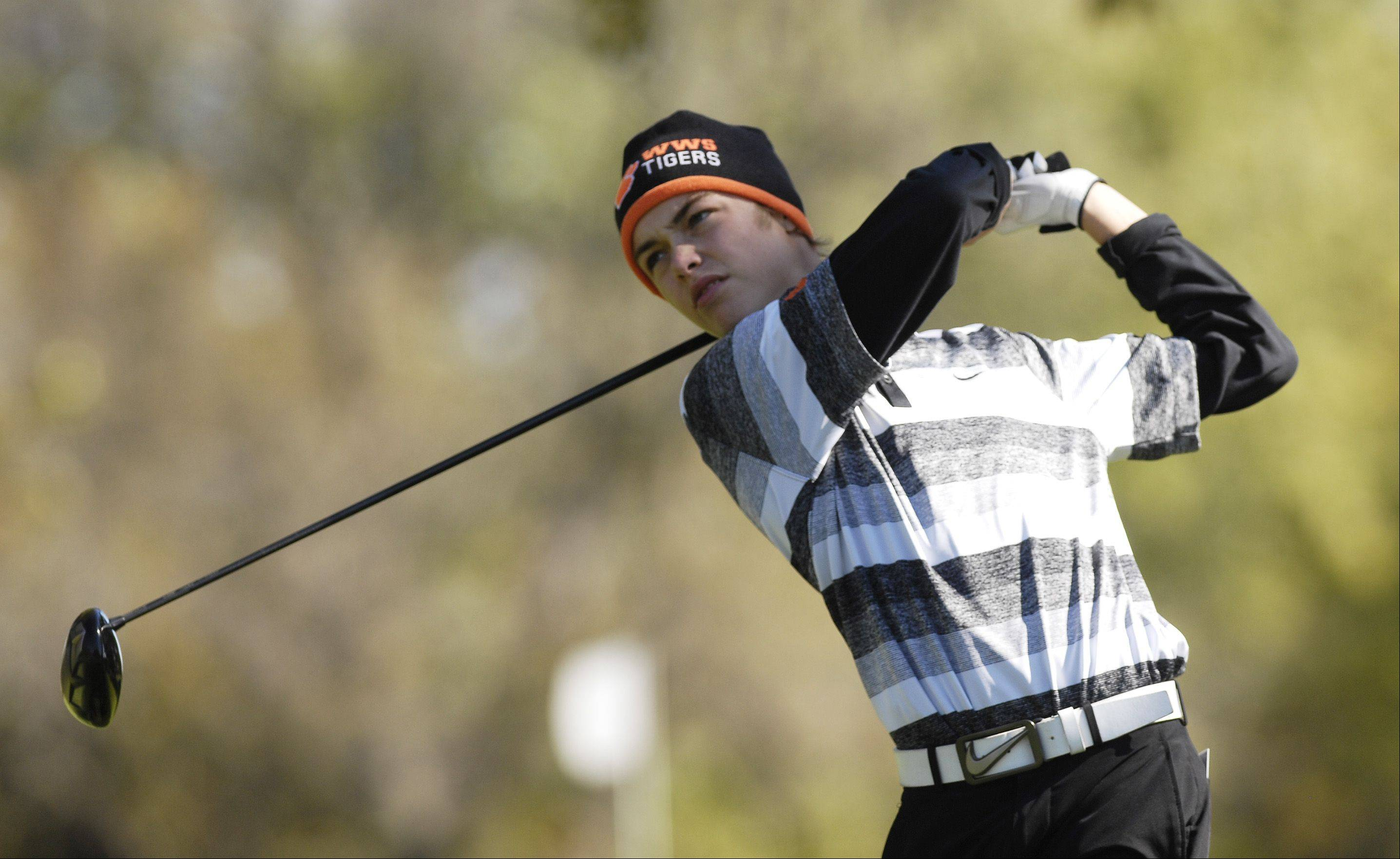 Tommy Dale of Wheaton Warrenville South tees off during the St. Charles East boys varsity golf sectional at St. Andrews Golf Club in West Chicago, Monday.