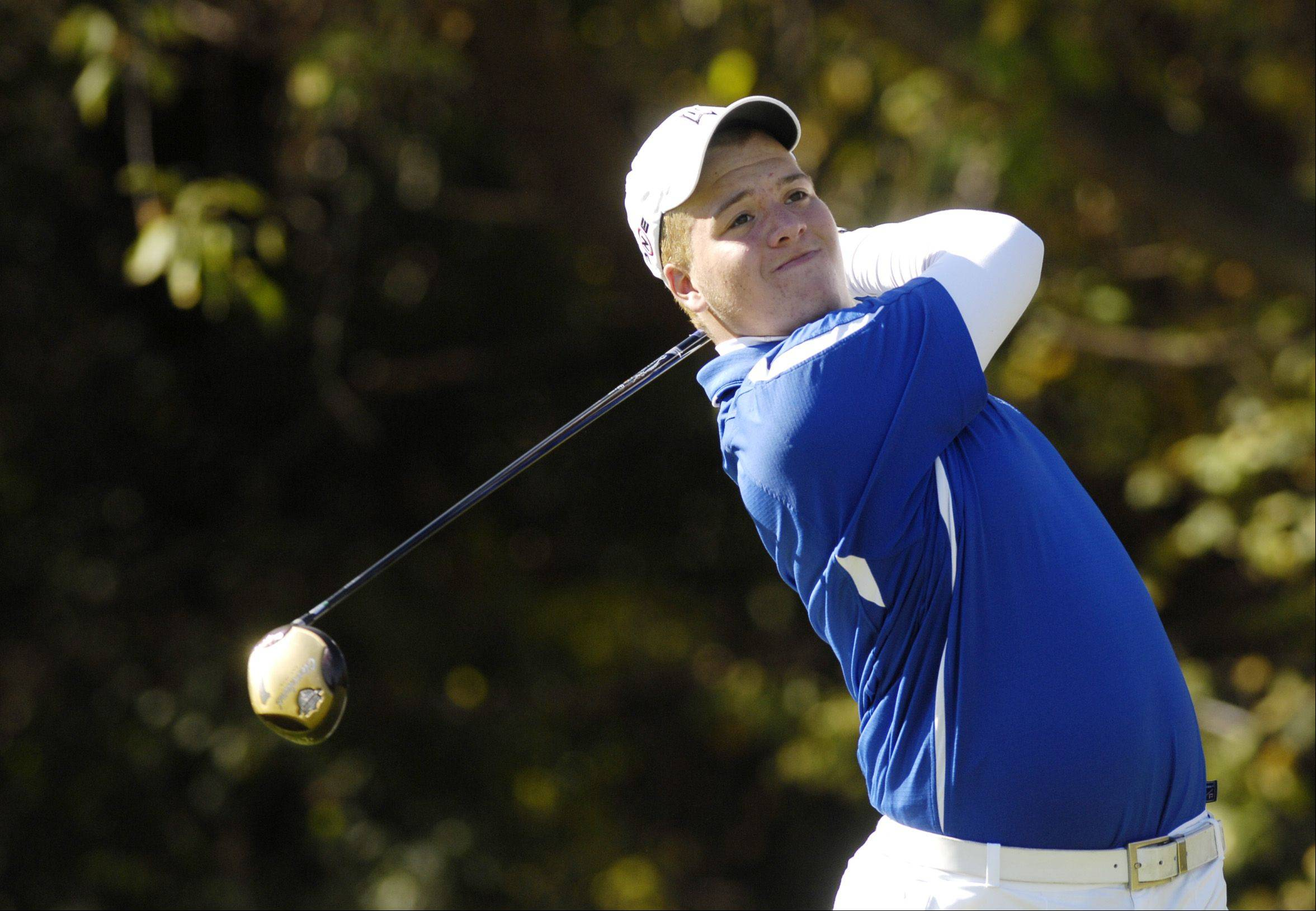 Nate Desens of Geneva tees off during the St. Charles East boys varsity golf sectional at St. Andrews Golf Club in West Chicago, Monday.