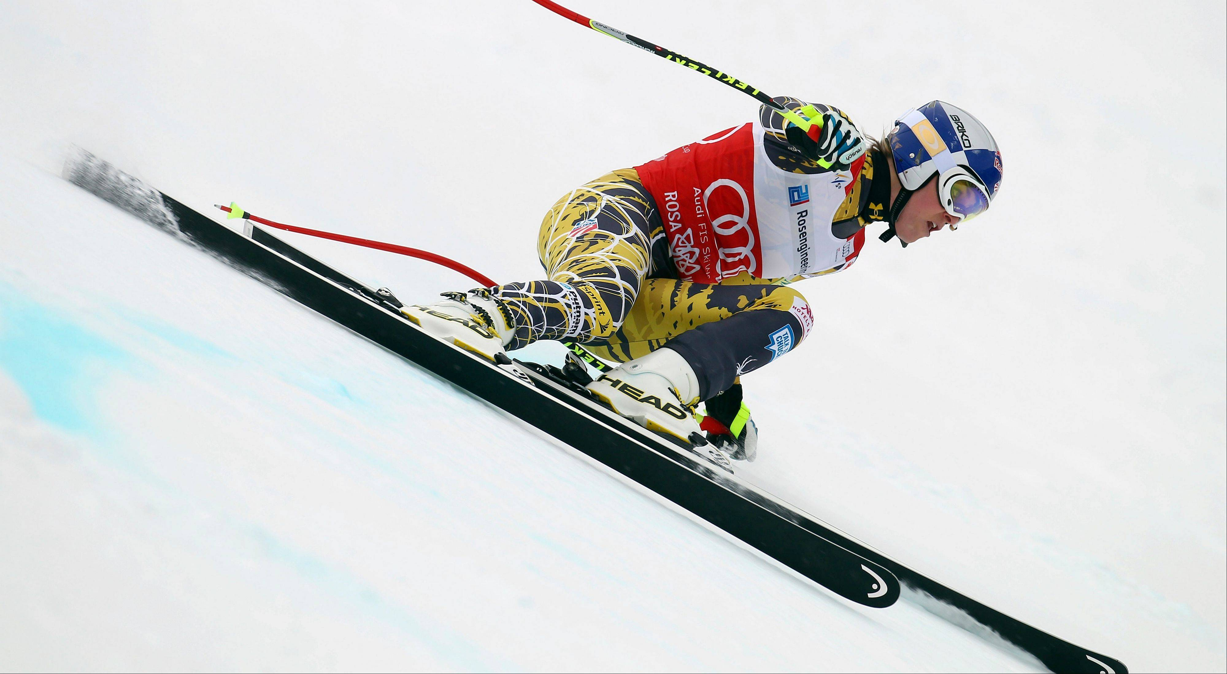 "In this Feb. 18, 2012 file picture Lindsey Vonn, of the United States, competes during a women's World Cup downhill on the Sochi Olympics course, in Krasnaya Polyana, near Sochi, Russia . The United States ski team says it hasn't had any ""formal discussion"" yet about the possibility of Lindsey Vonn entering a men's World Cup downhill next month. Vonn, the women's Olympic downhill champion, has written the International Ski Federation to ask whether she can challenge the men on Nov. 24 in Lake Louise, Alberta."