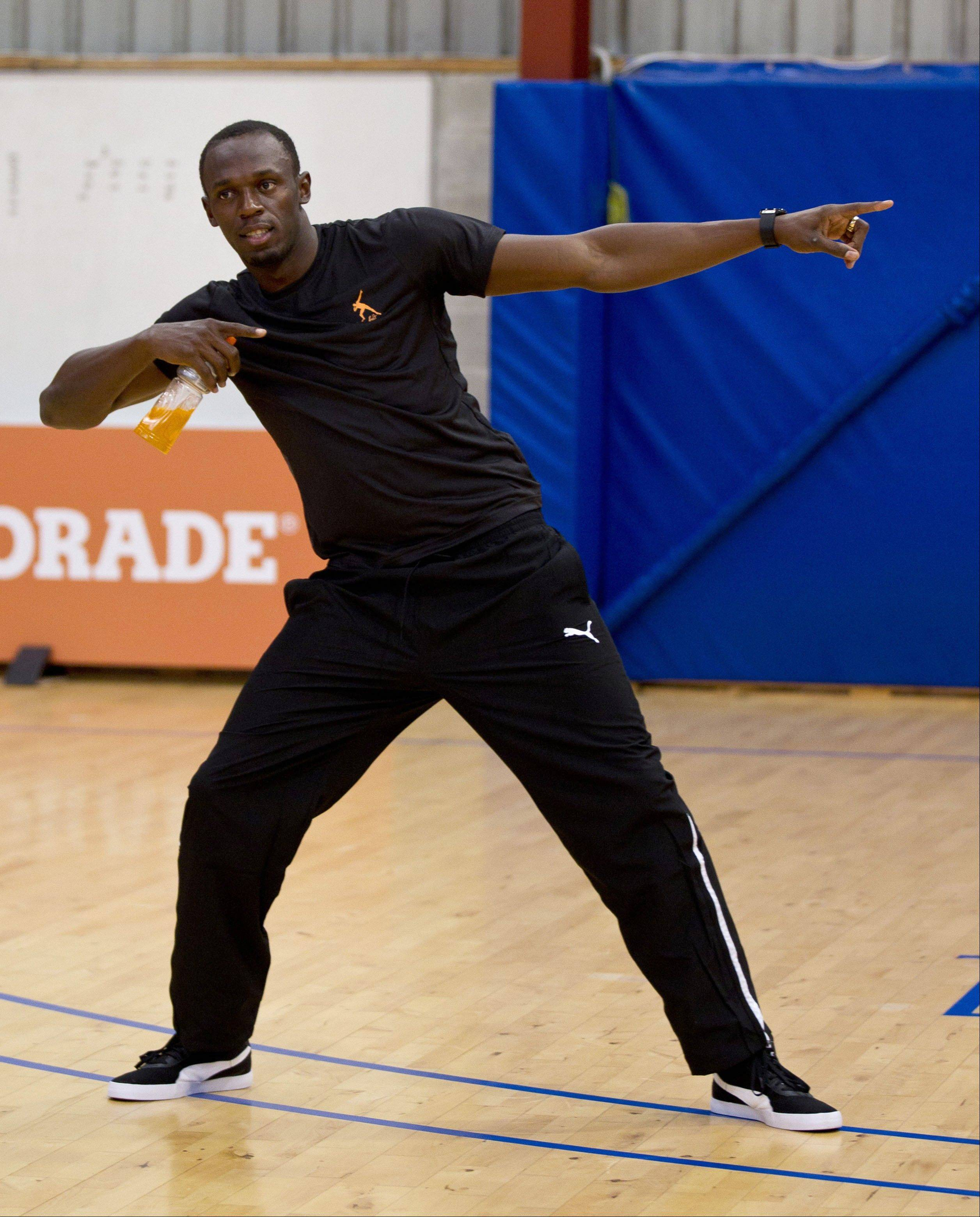 London Olympics champion Usain Bolt does a traditional challenge dance during the Breakers' basketball team event at their training facility at Mairangi Bay in Auckland, New Zealand, Monday, Oct 8, 2012. The legendary Jamaican sprinter is making a short visit to New Zealand after holidaying in Australia.
