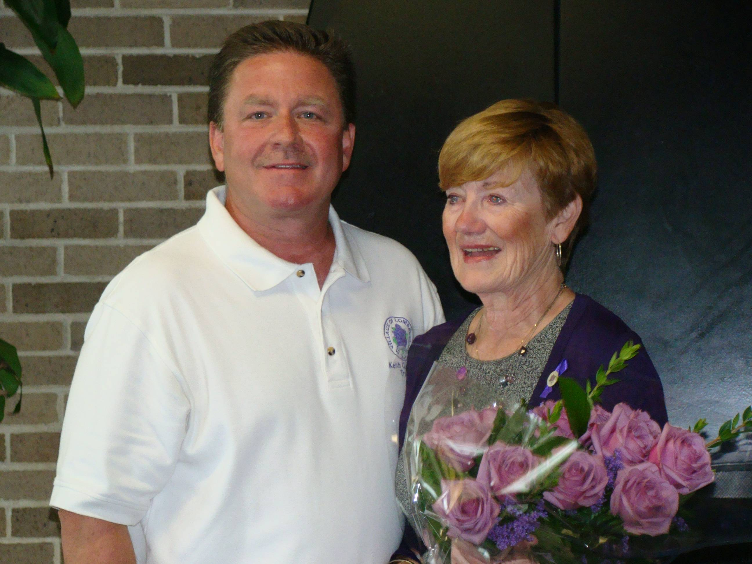 "Trustee Keith Giagnorio congratulates Eileen Mueller who accepted the ""Senior of the Year"" award on behalf of her late husband, Bill Mueller, at last week's Senior Fair."