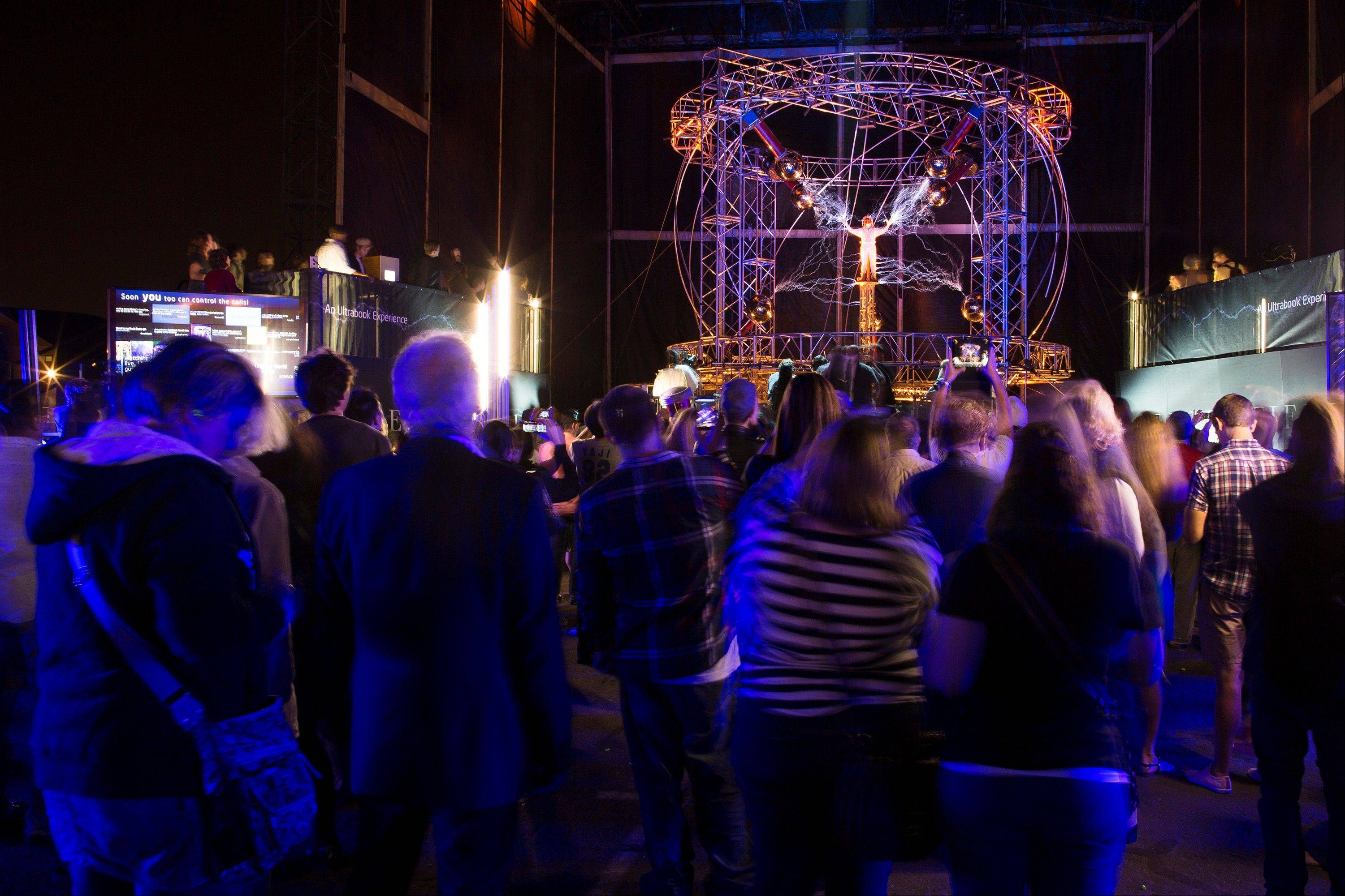 Magician David Blaine stands inside an apparatus surrounded by a million volts of electric currents streamed by tesla coils during his 72-hour �Electrified: 1 Million Volts Always On� stunt on Pier 54.