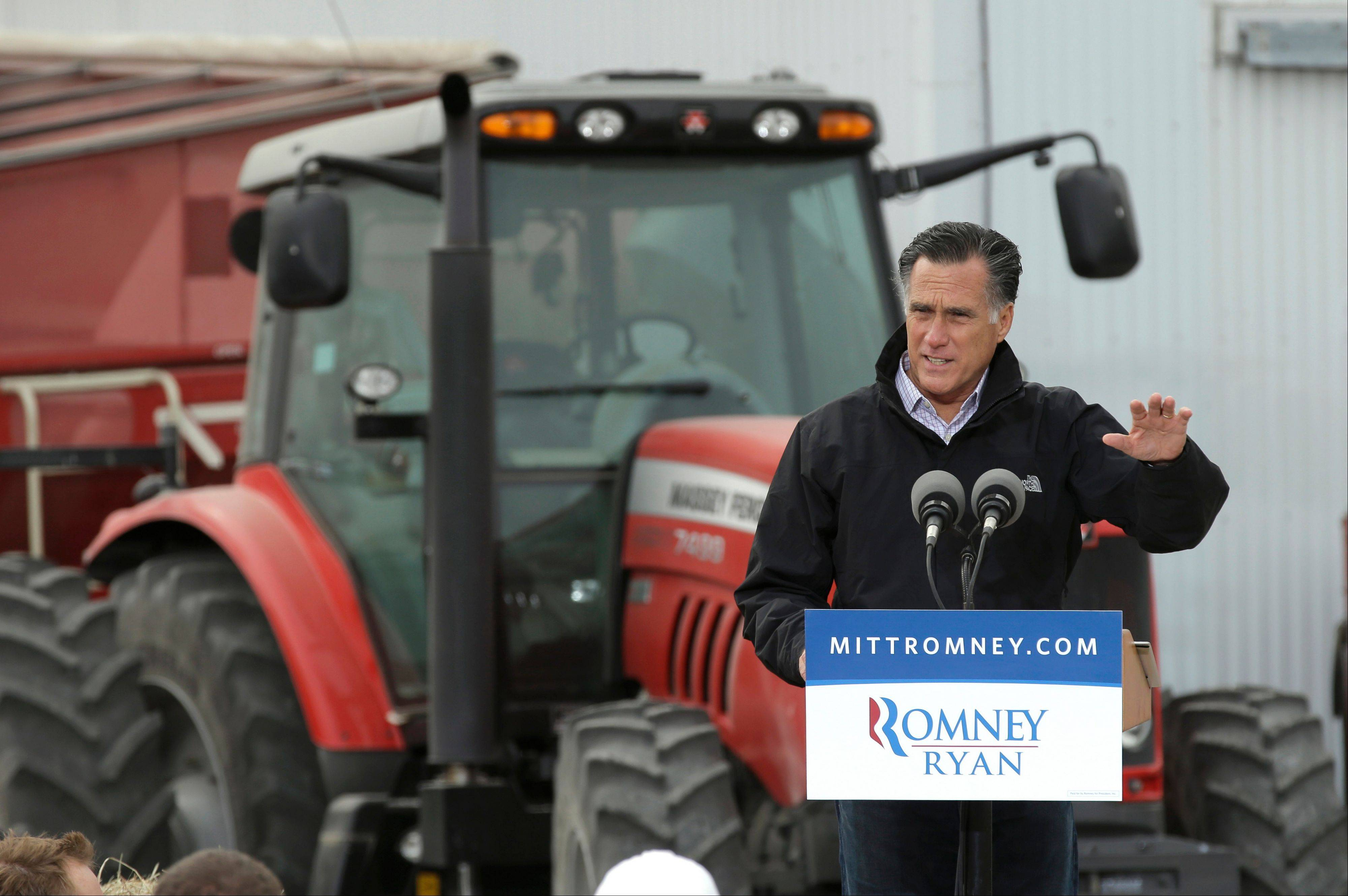 Republican presidential candidate and former Massachusetts Gov. Mitt Romney speaks Tuesday during a campaign stop at the Koch Family Farm in Van Meter, Iowa.