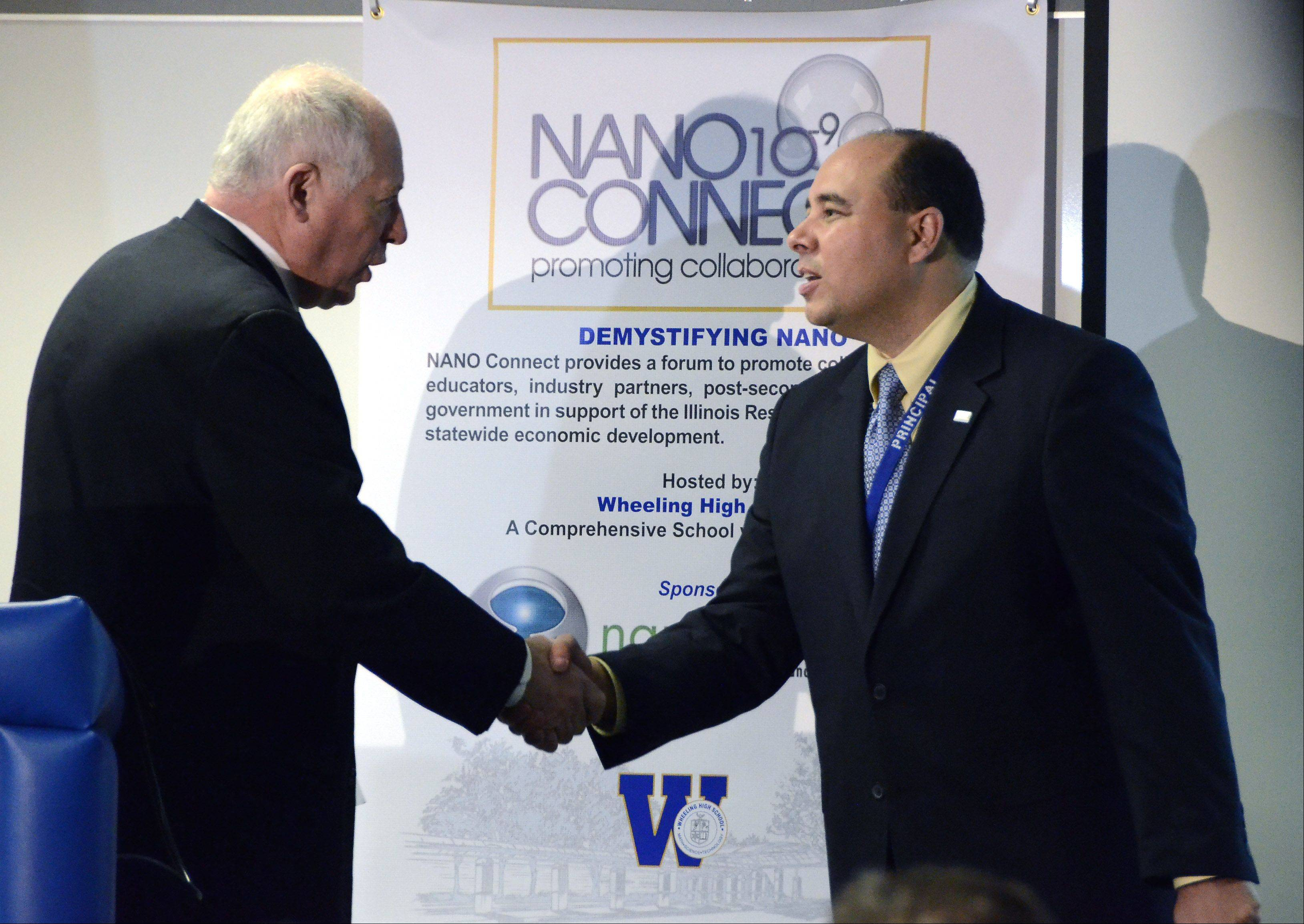 Gov. Pat Quinn, left, thanks Wheeling High School Principal Lazaro Lopez for his work on incorporating STEM educations into the high school�s curriculum.