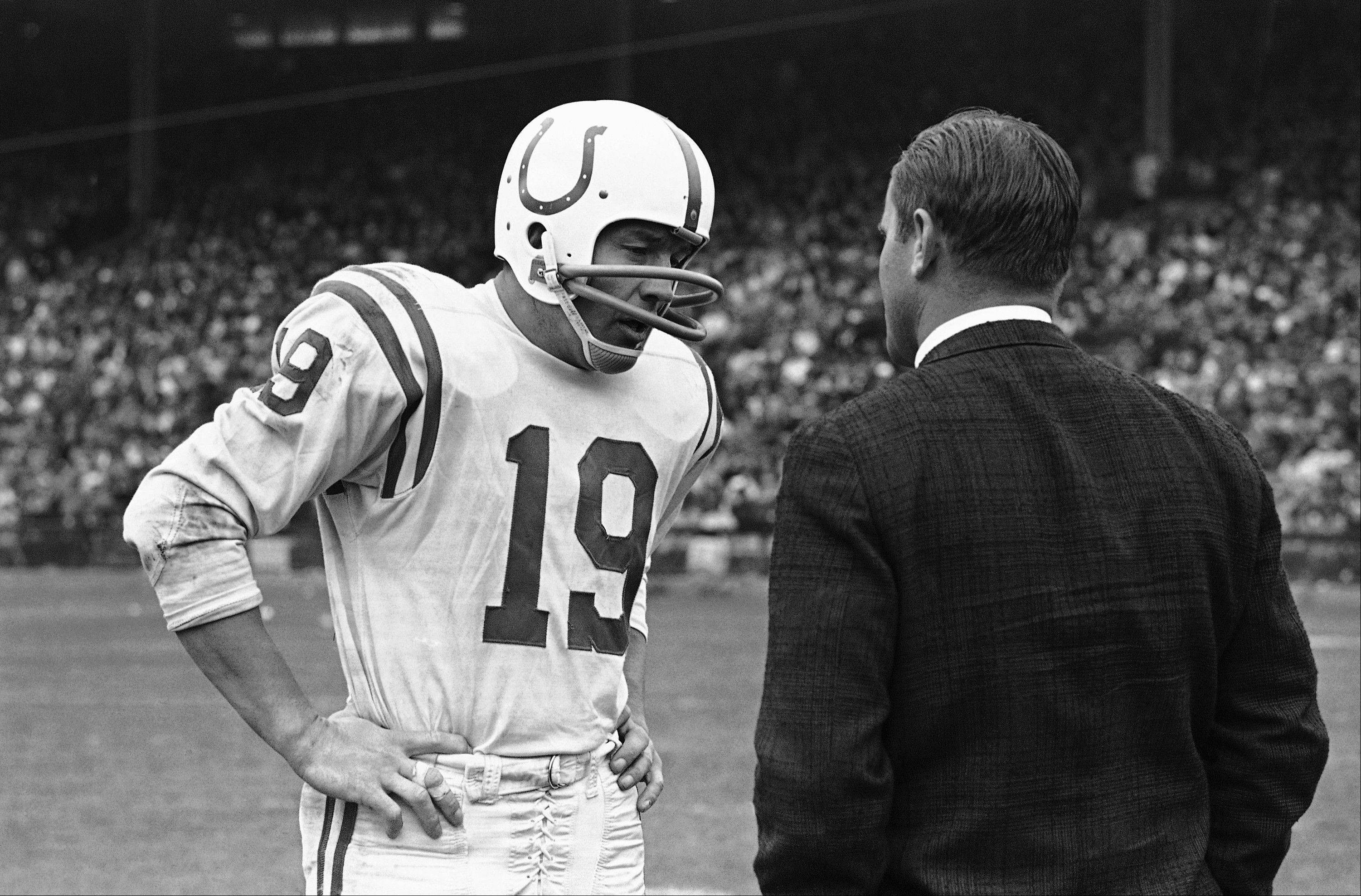 Baltimore Colts quarterback John Unitas, here talking with coach Don Shula, held the NFL record with 47 consecutive games with a touchdown pass until Drew Brees broke it Sunday.