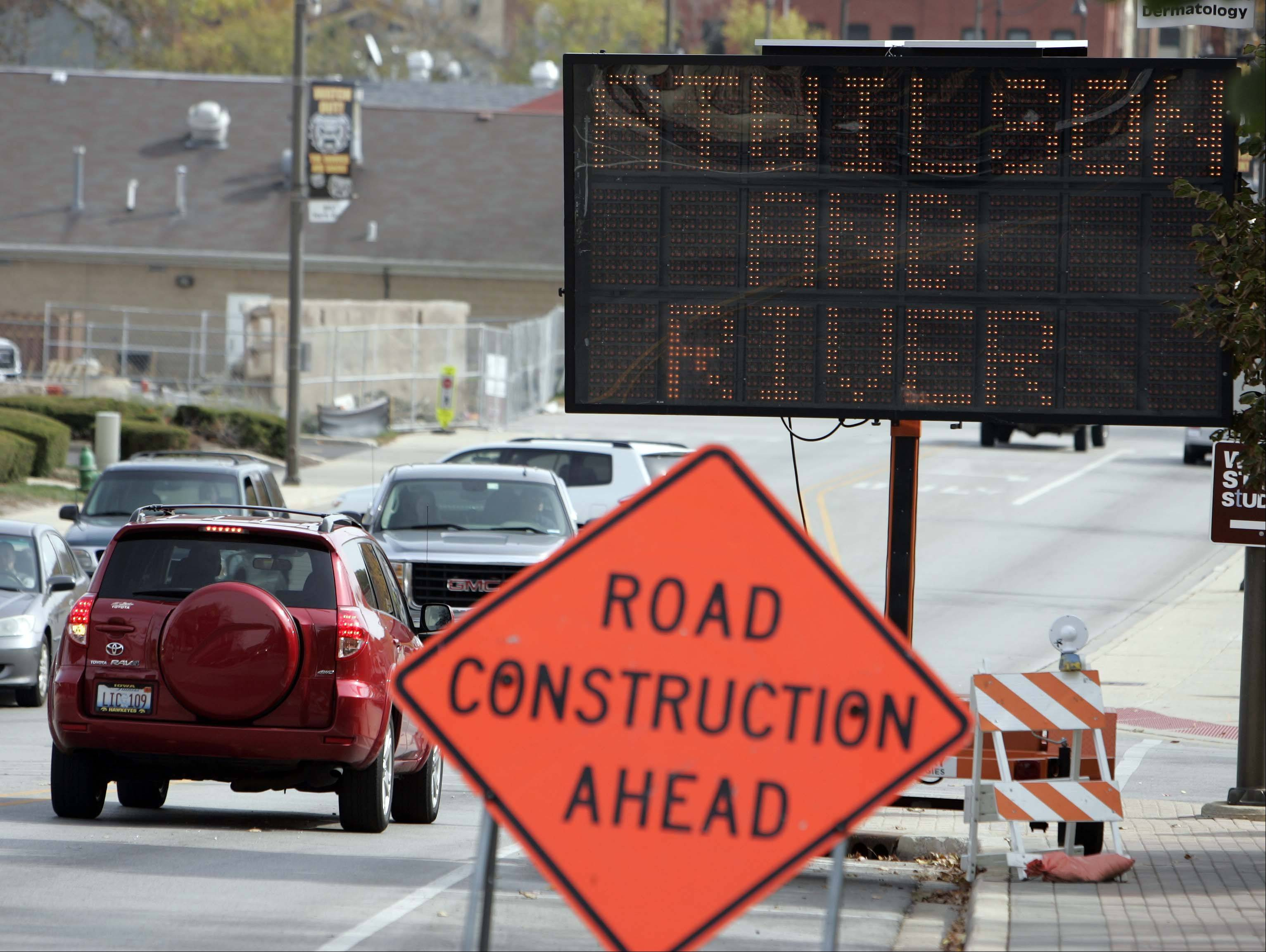 A sign on Wilson Street notes the construction of the streetscape on North River Street in downtown Batavia.
