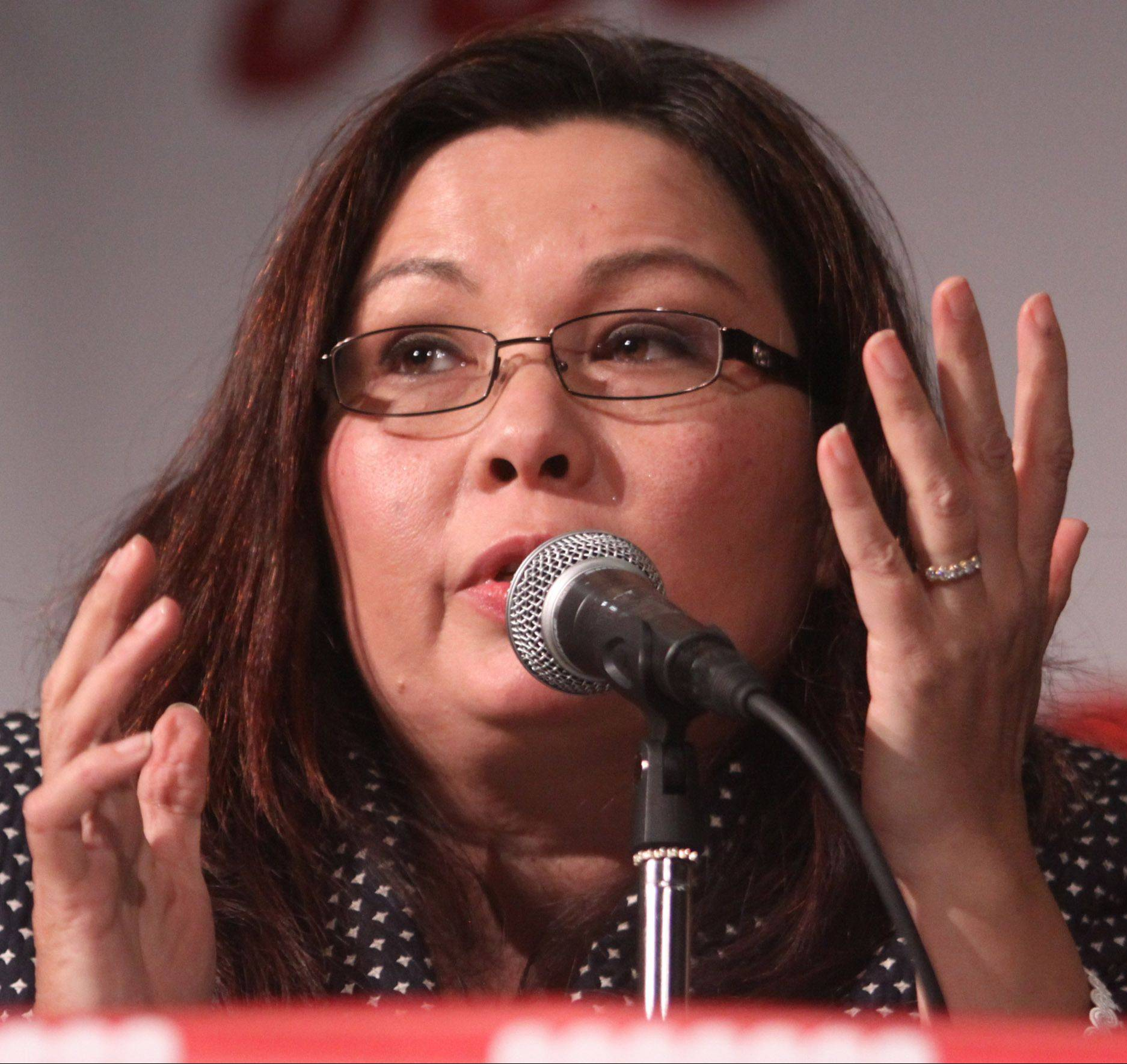 Tammy Duckworth speaks at Tuesday's debate in Rolling Meadows.