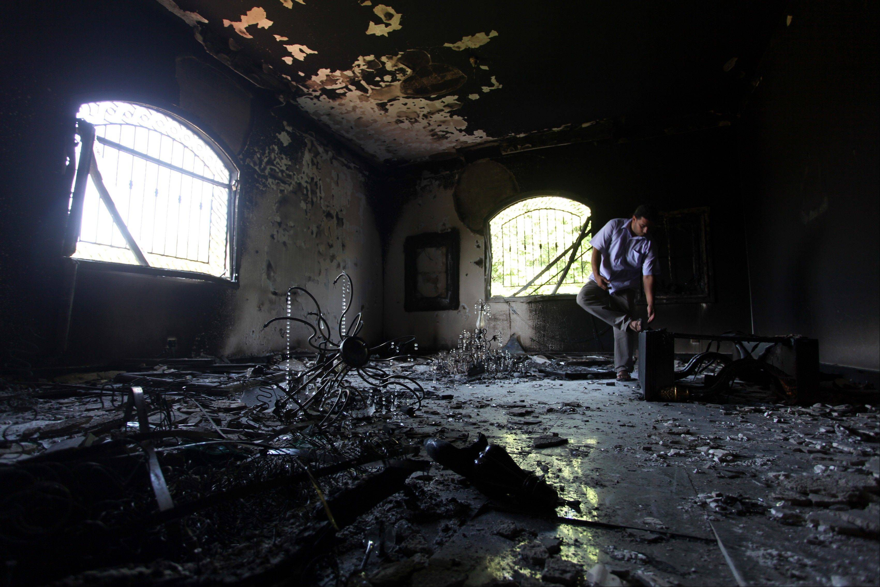 A Libyan man investigates the inside of the U.S. Consulate, after an attack that killed four Americans, including Ambassador Chris Stevens on the night of Sept. 11, 2012, in Benghazi, Libya. The State Department on Tuesday said it never concluded that the consulate attack in Libya stemmed from protests over an American-made video ridiculing Islam, raising further questions about why the Obama administration used that explanation for more than a week after assailants killed the U.S. ambassador and three other Americans.