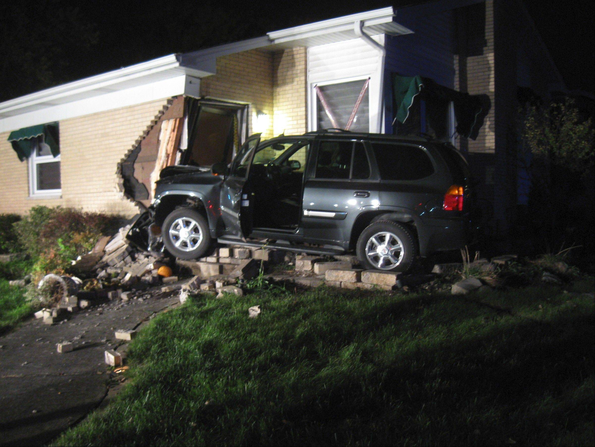 Two people were injured when a 17-year-old driver slammed her SUV into a Glen Ellyn home at the corner of Park Boulevard and Pershing Road Monday night, police said.