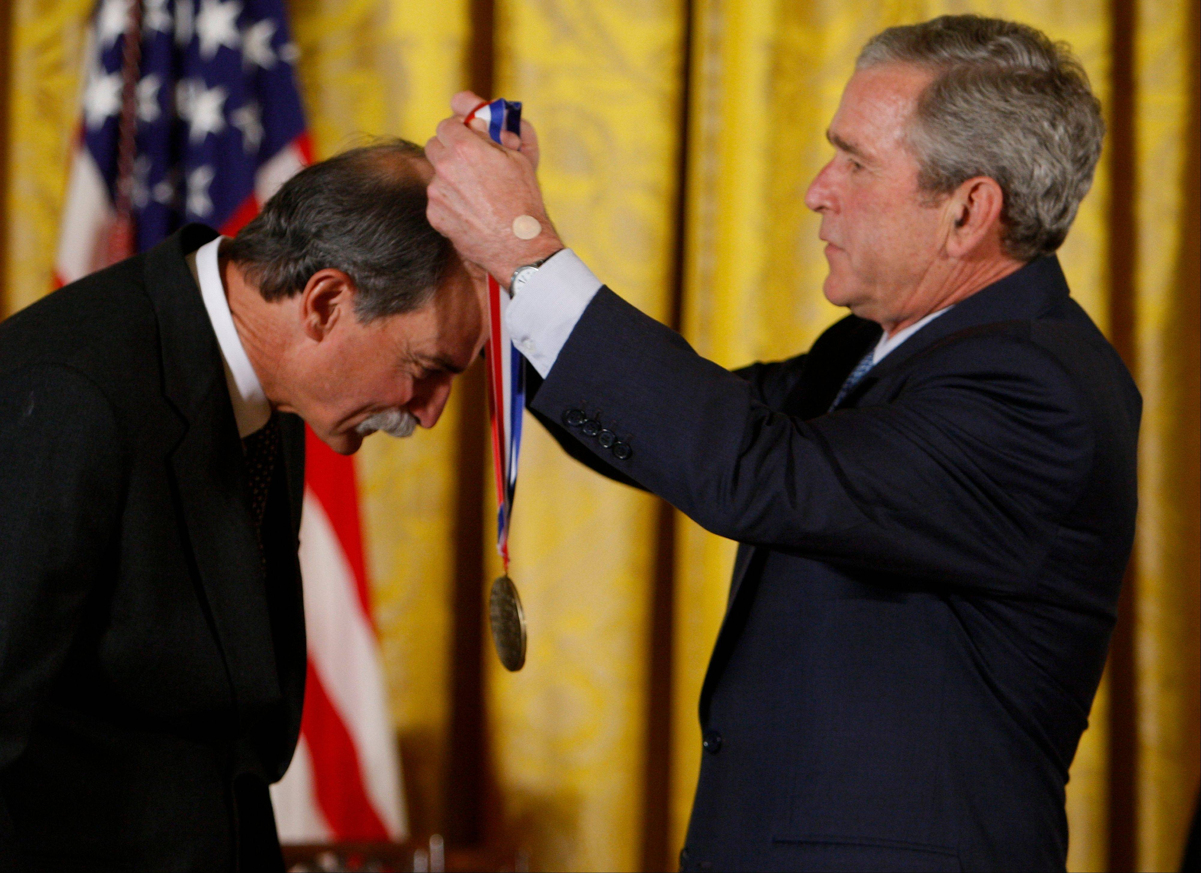 In this 2008 photo, President George W. Bush presents David J. Wineland of the National Institute of Standards and Technology, Boulder, Colo., with the 2007 National Medal of Science award in the East Room of the White House in Washington. Wineland and Frenchman Serge Haroche have won the 2012 Nobel Prize in physics.