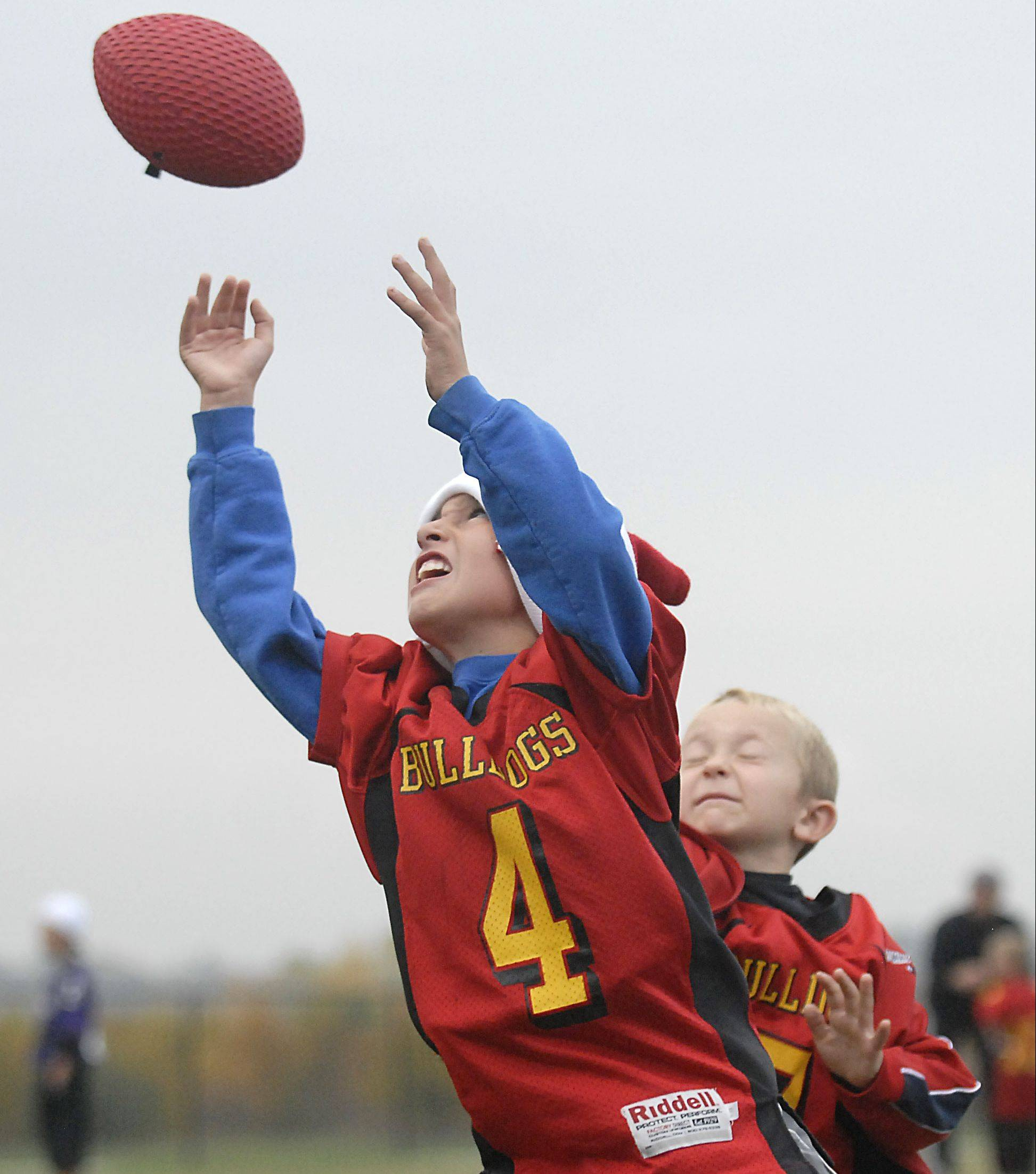 Alex Breytspraak reaches for a pass in front of Zach Sledz, both 7 and from Aurora, during a Batavia Youth Football league game at West Main Park in Batavia.