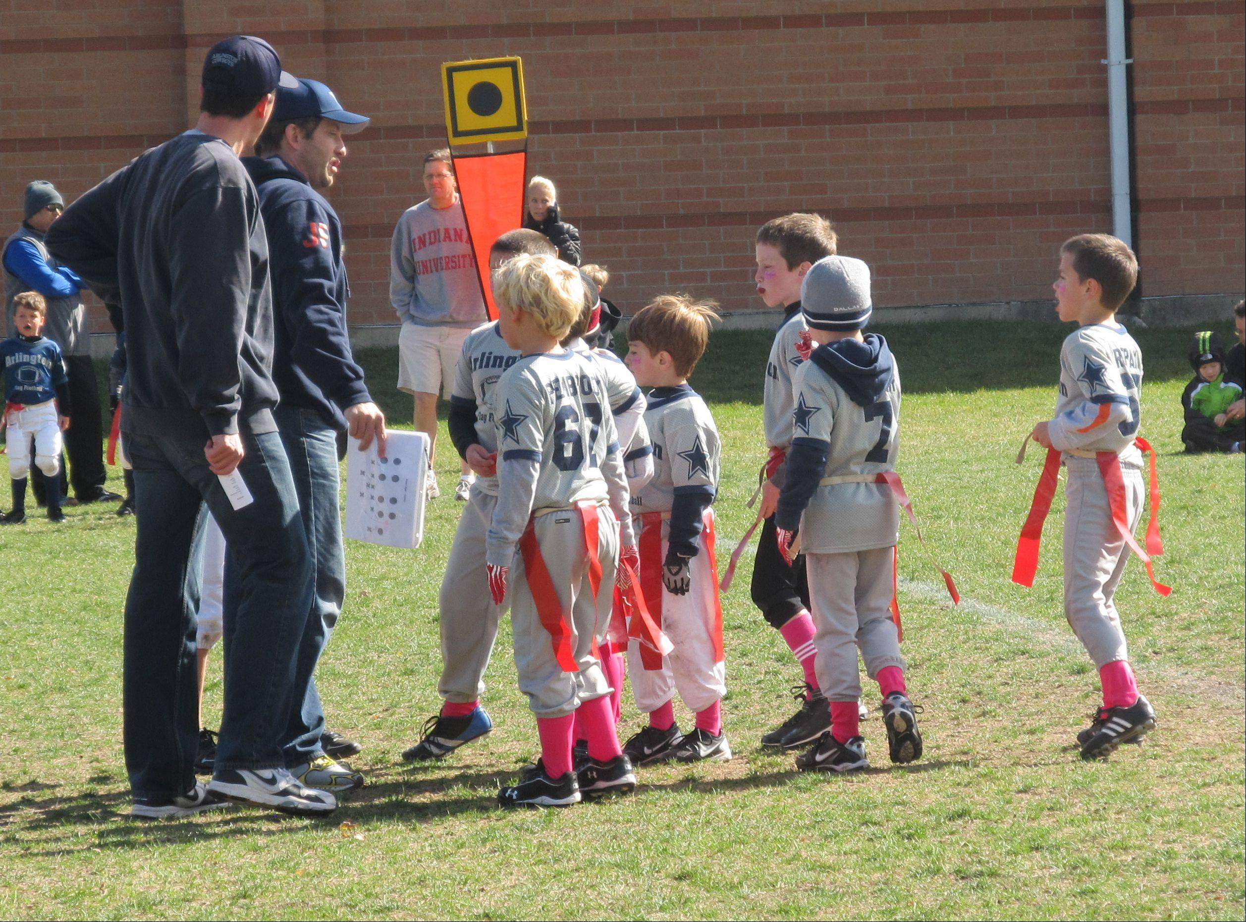 First- and second-graders play flag football with the Arlington Cowboys league Saturday in Arlington Heights.