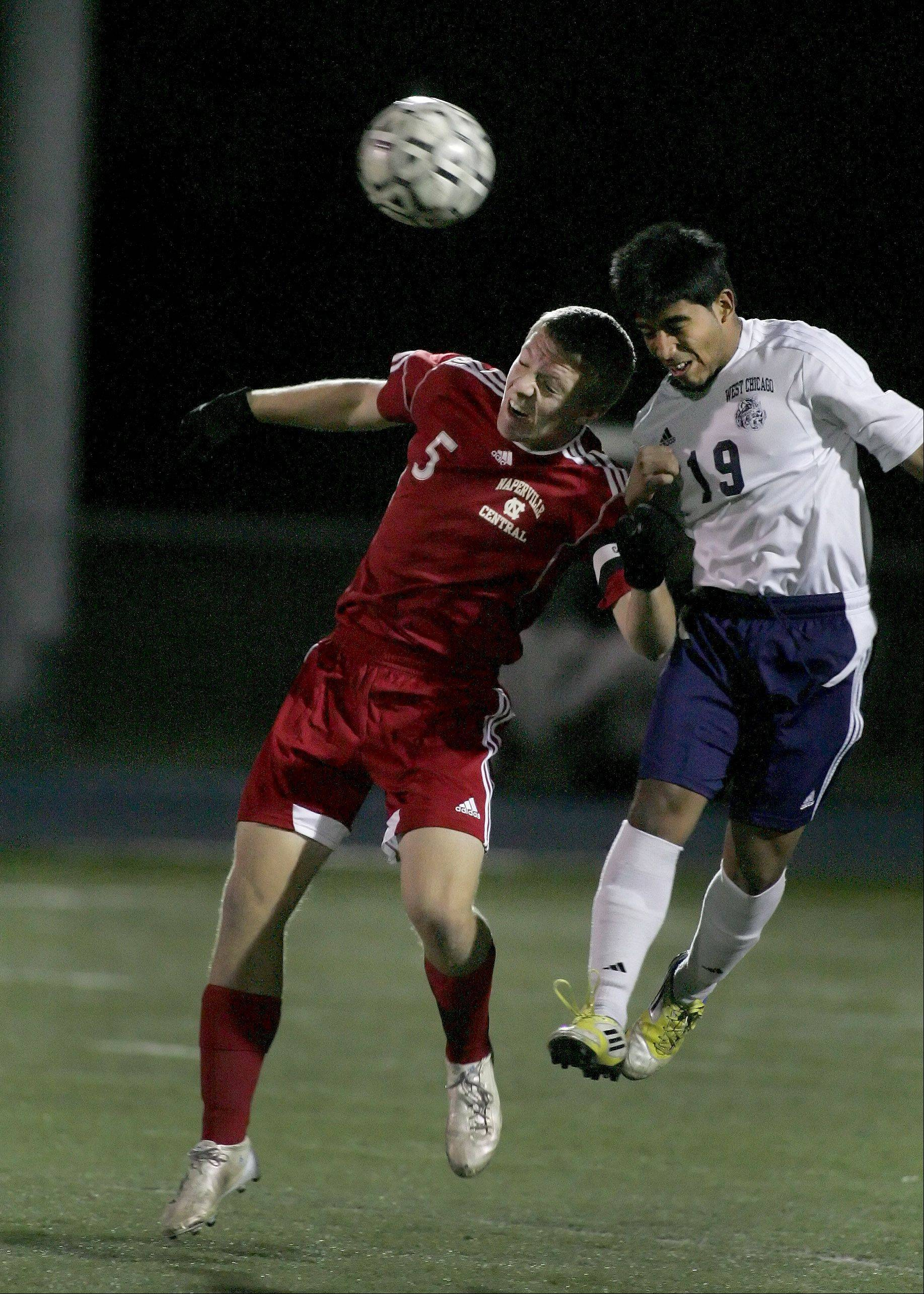Pat Flynn of Naperville Central, left, and Giovannie Altamirano, right, of West Chicago in boys soccer action on Tuesday.