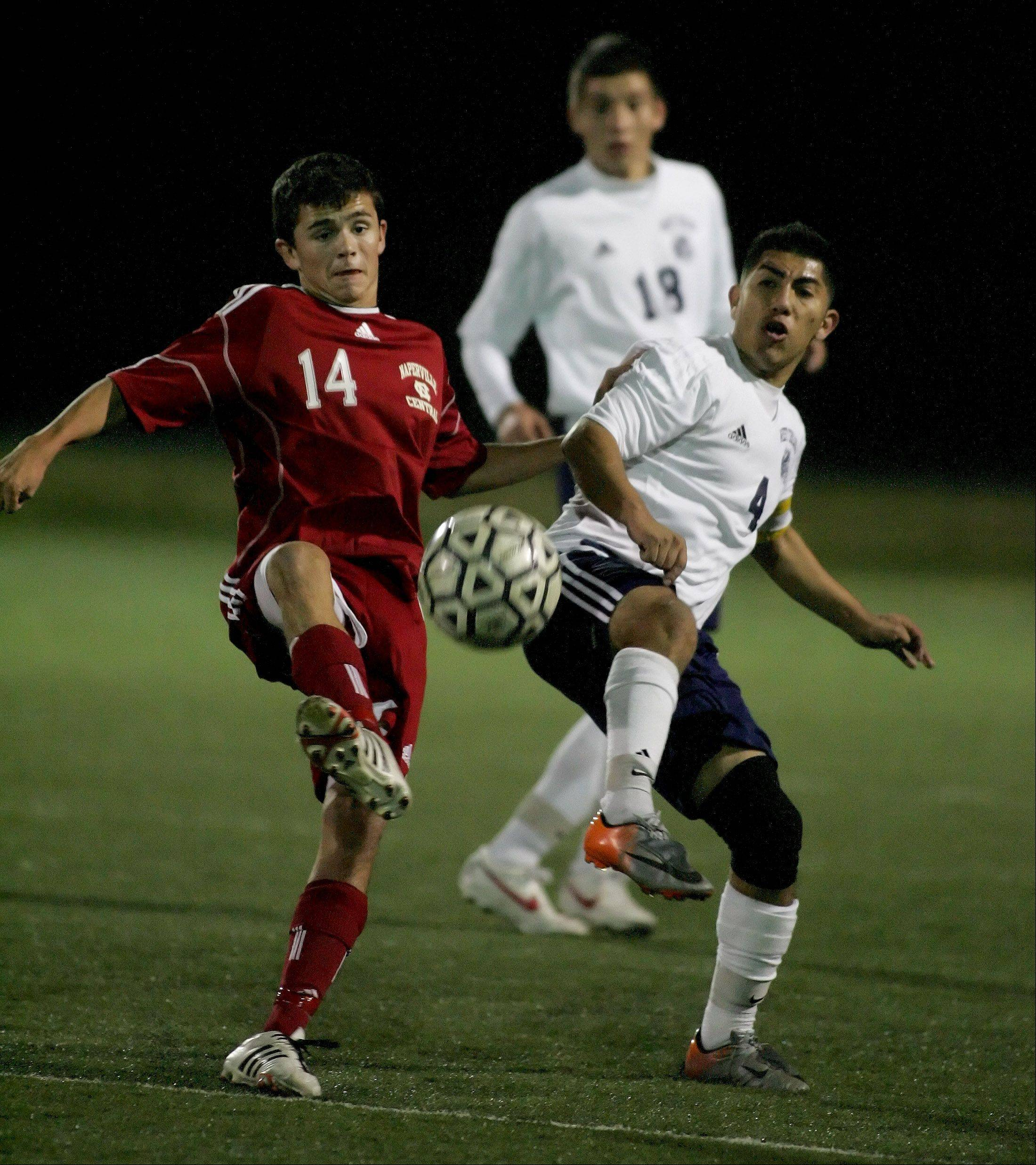 David Murphy, left, of Naperville Central and Daniel Hernandez, right, of West Chicago in boys soccer action on Tuesday.