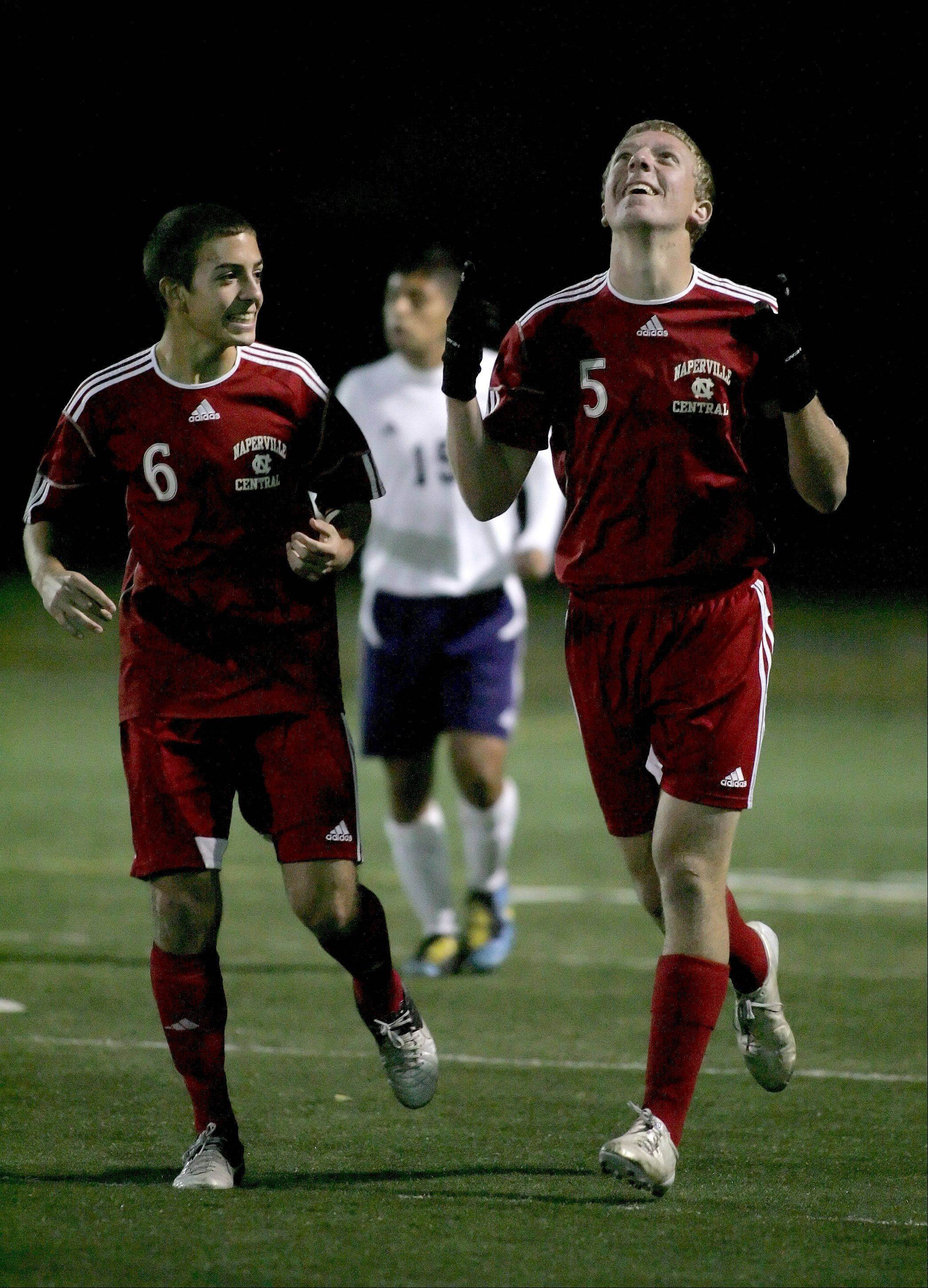 Pat Flynn, right, of Naperville Central celebrates his goal early in the first half with teammate Mike West, left, during boys soccer action at West Chicago on Tuesday.