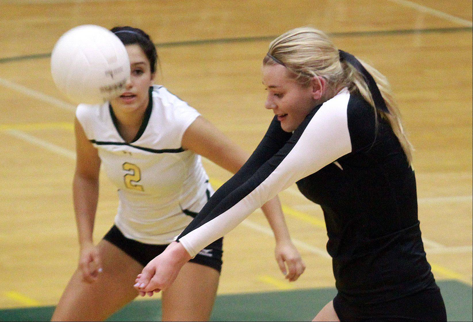 Fremd's Lane Hindenburg, right, prepares to bump as teammate Nina Scott keeps an eye on the action against Palatine on Tuesday at Fremd.