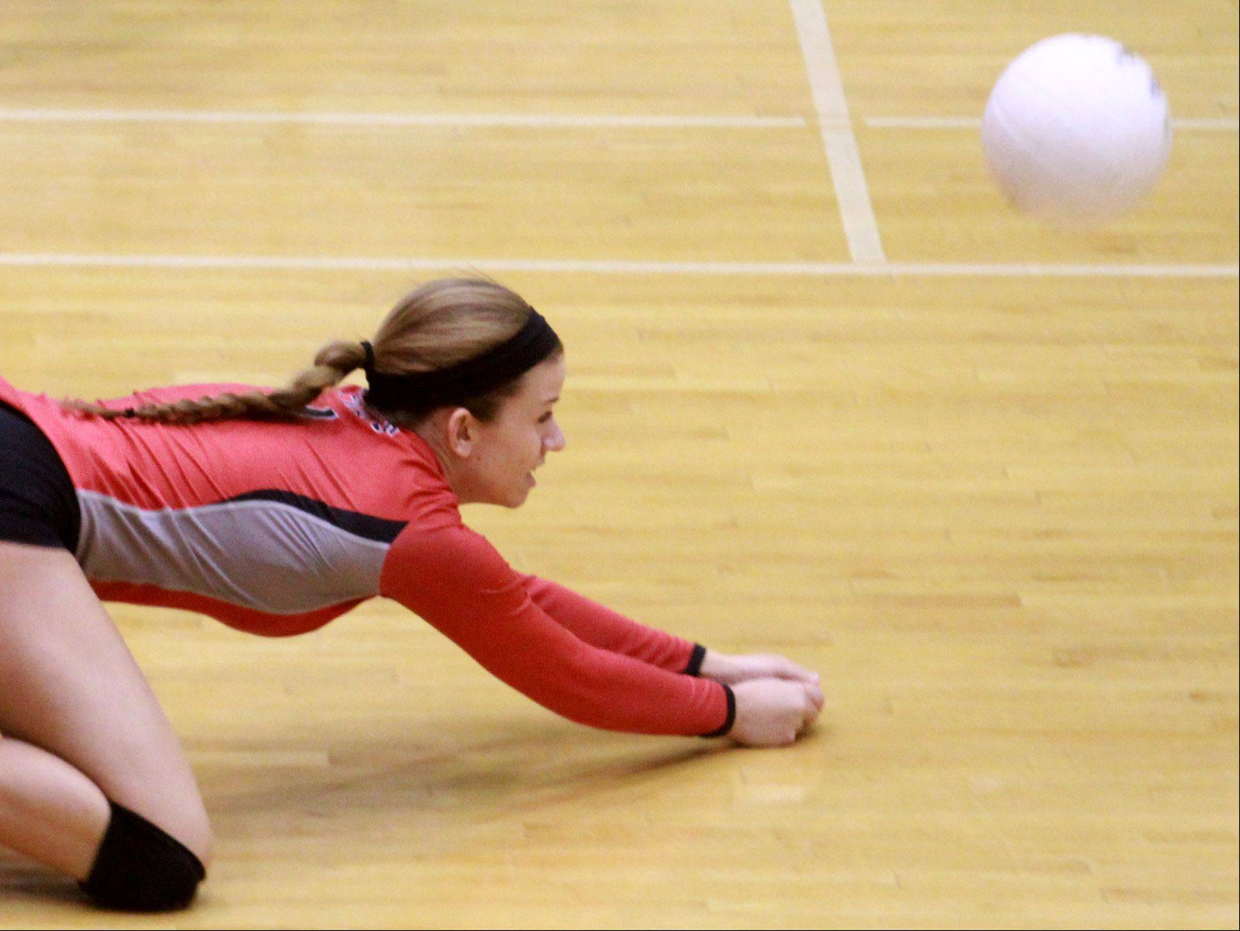 Palatine's Casey Dolen prepares to dig the ball against host Fremd on Tuesday night.