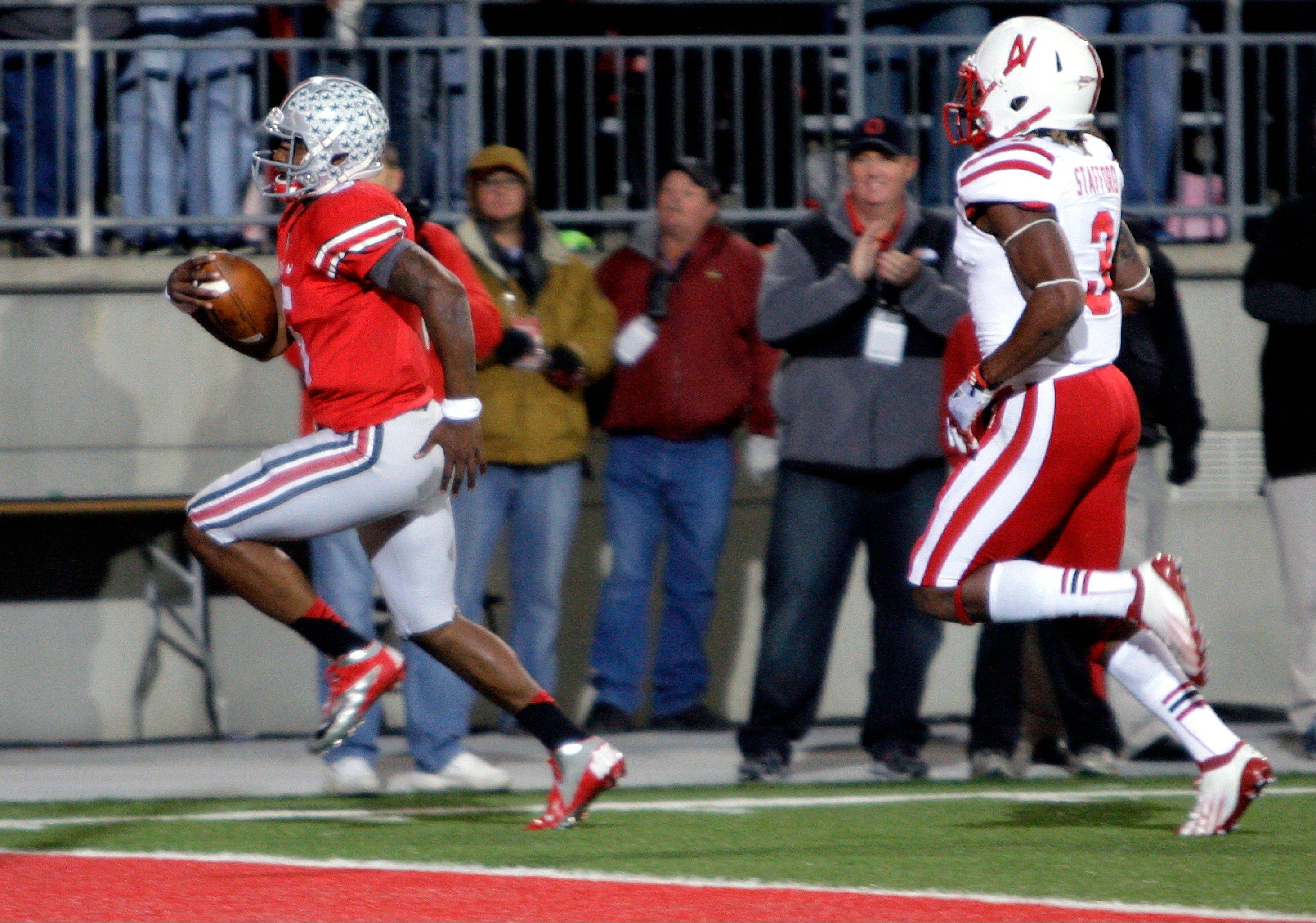 Ohio State quarterback Braxton Miller, left, scores a touchdown Saturday against Nebraska safety Daimion Stafford during the second quarter.