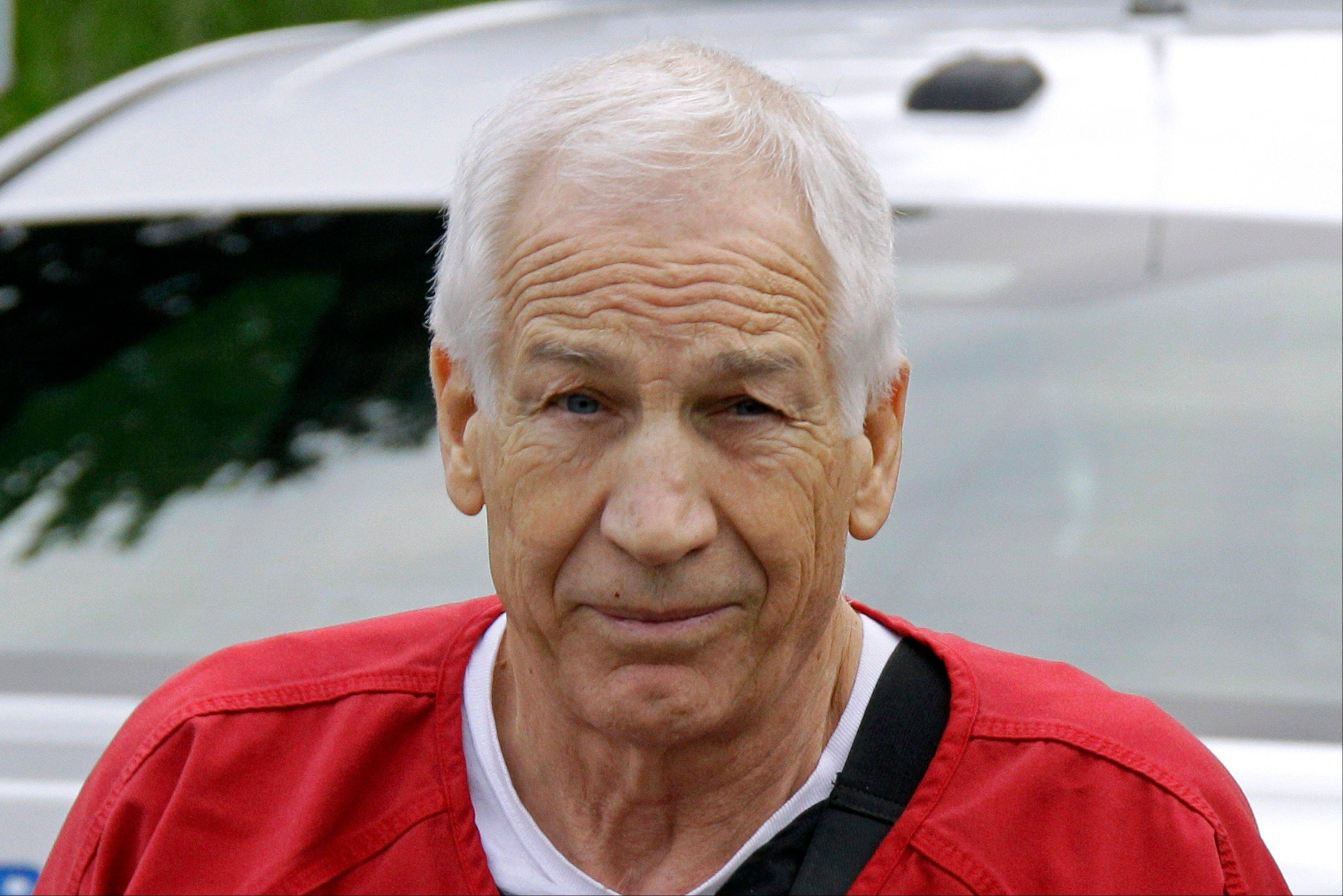 Former Penn State University assistant football coach Jerry Sandusky arrives for sentencing at the Centre County Courthouse in Bellefonte, Pa., Tuesday, Oct. 9, 2012.