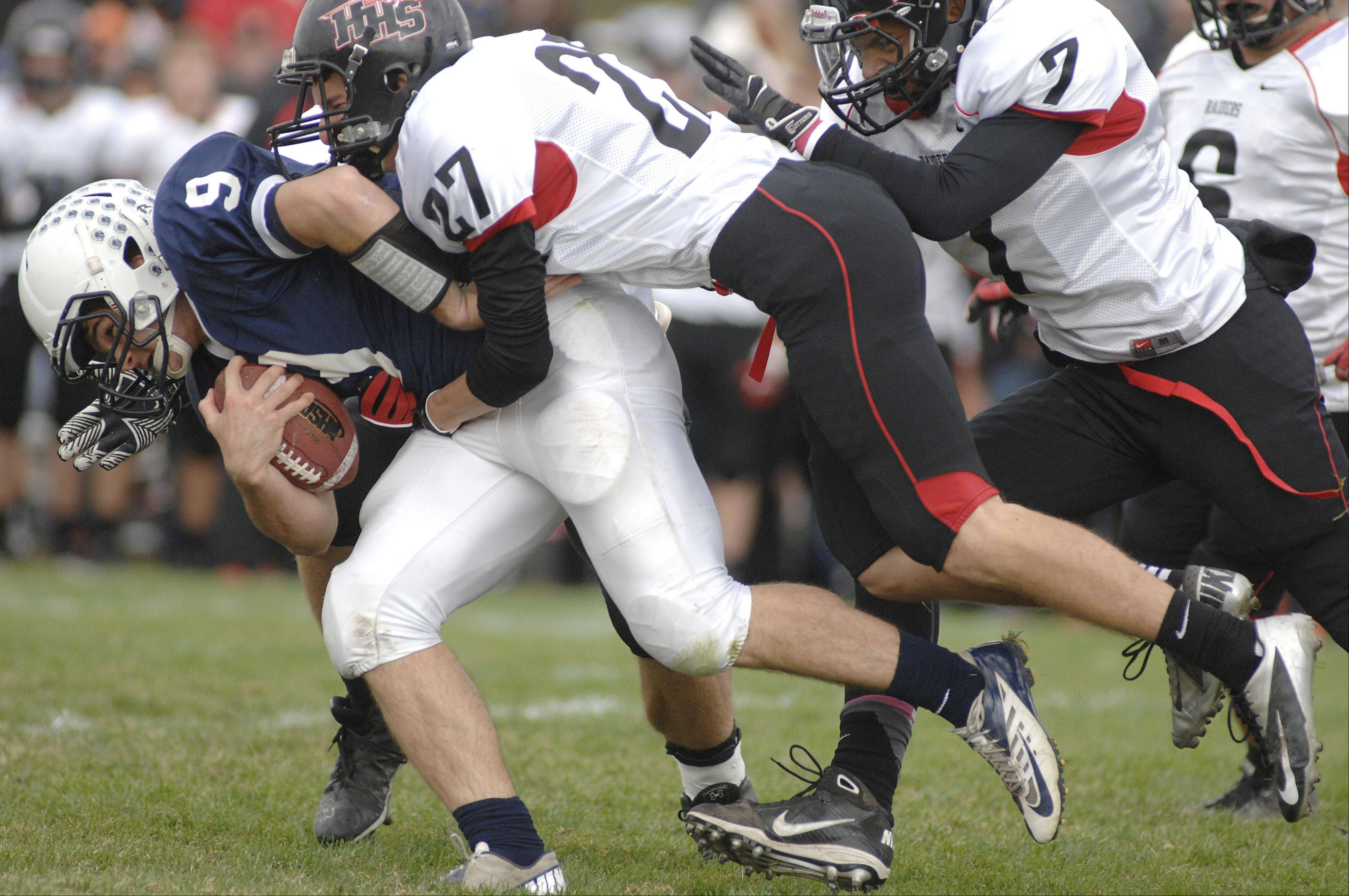 Cary-Grove's Wuinn Baker tries to shake off Huntley's Josh Sepsey and Damario Hughes in the second quarter Saturday.