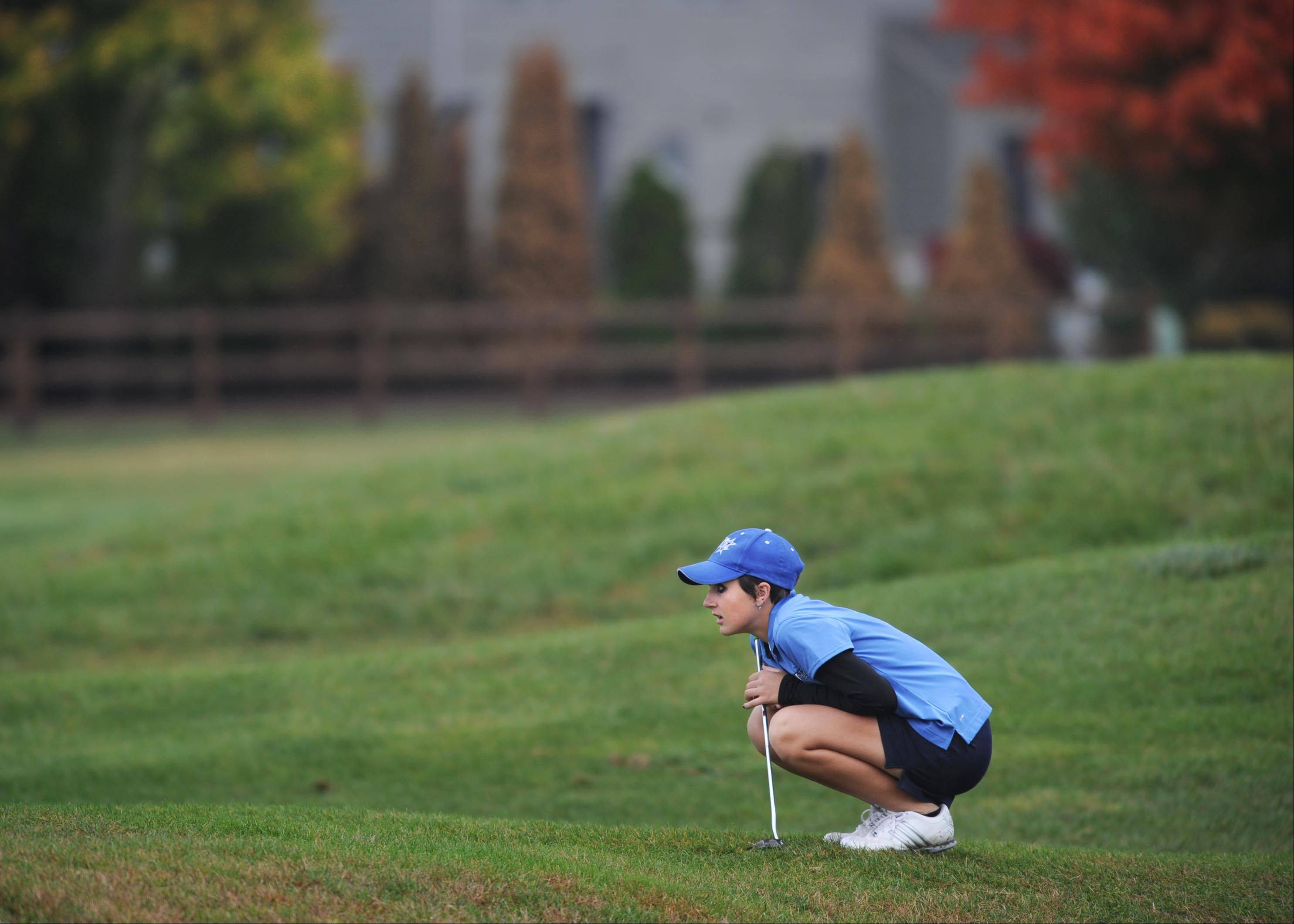 St. Charles North's Ariana Furrie lines up a shot at the Regional golf tournament Wednesday at the Golf Club of Illinois in Algonquin.