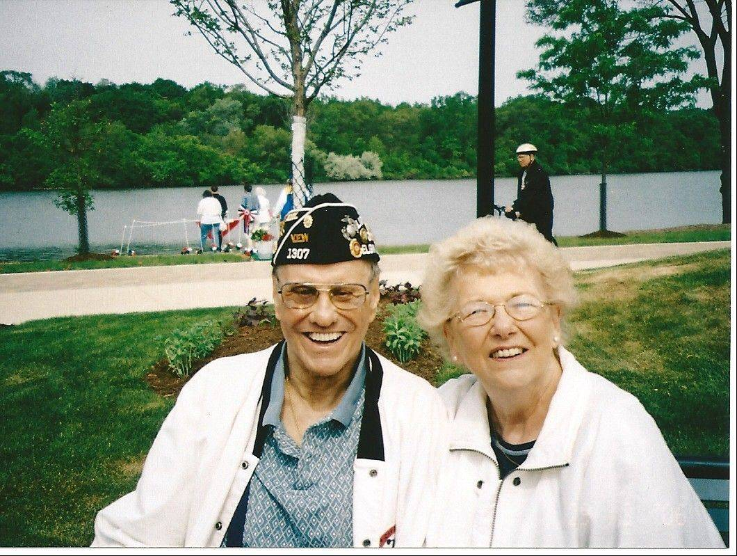 "Donald T. Anderson and his wife Nancy pose at the Elgin Veterans Memorial Park. One of the gardens at the ""Phase II"" waterfront addition to the memorial will be named in Anderson's honor."