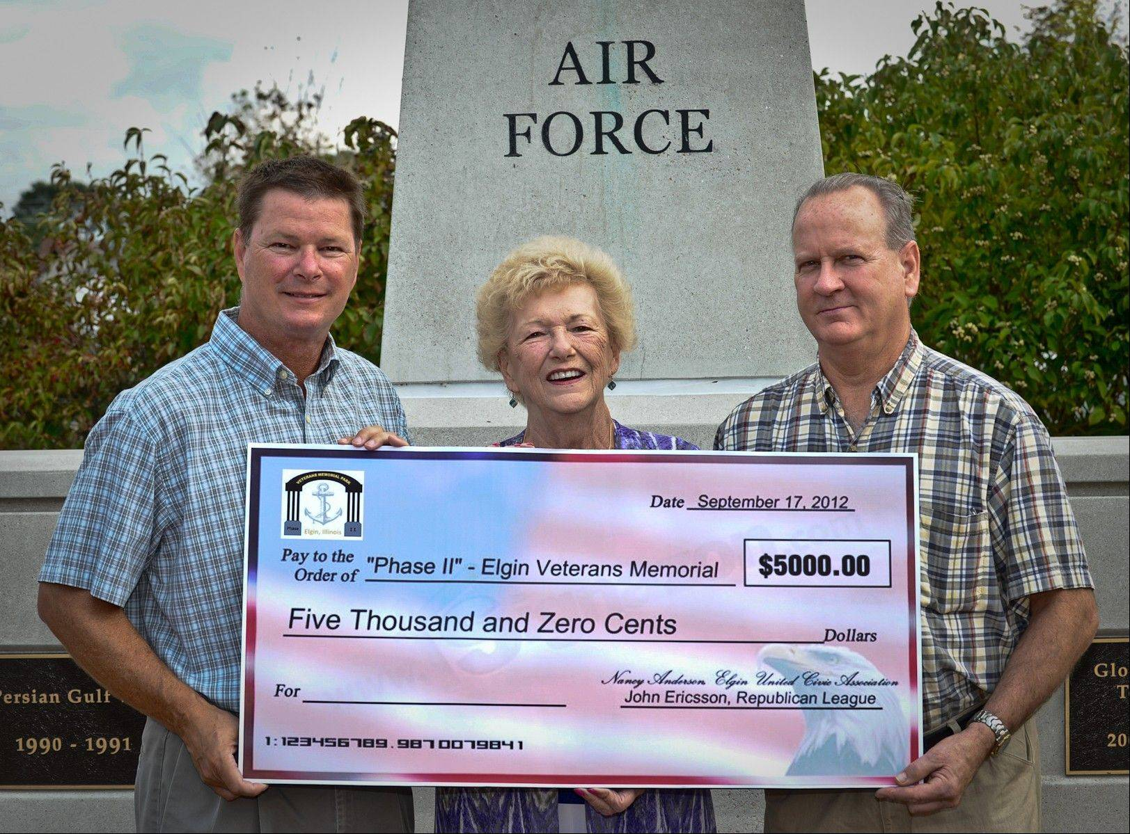 "A $5,000 donation was recently given to the ""Phase II"" committee in memory of Donald T. Anderson. Pictured, from left, are Scott Johnson, son of Donald T. and Nancy Anderson and president of the John Ericsson Republican League, Nancy Anderson, and George Bero, Elgin United Civic Association delegate."