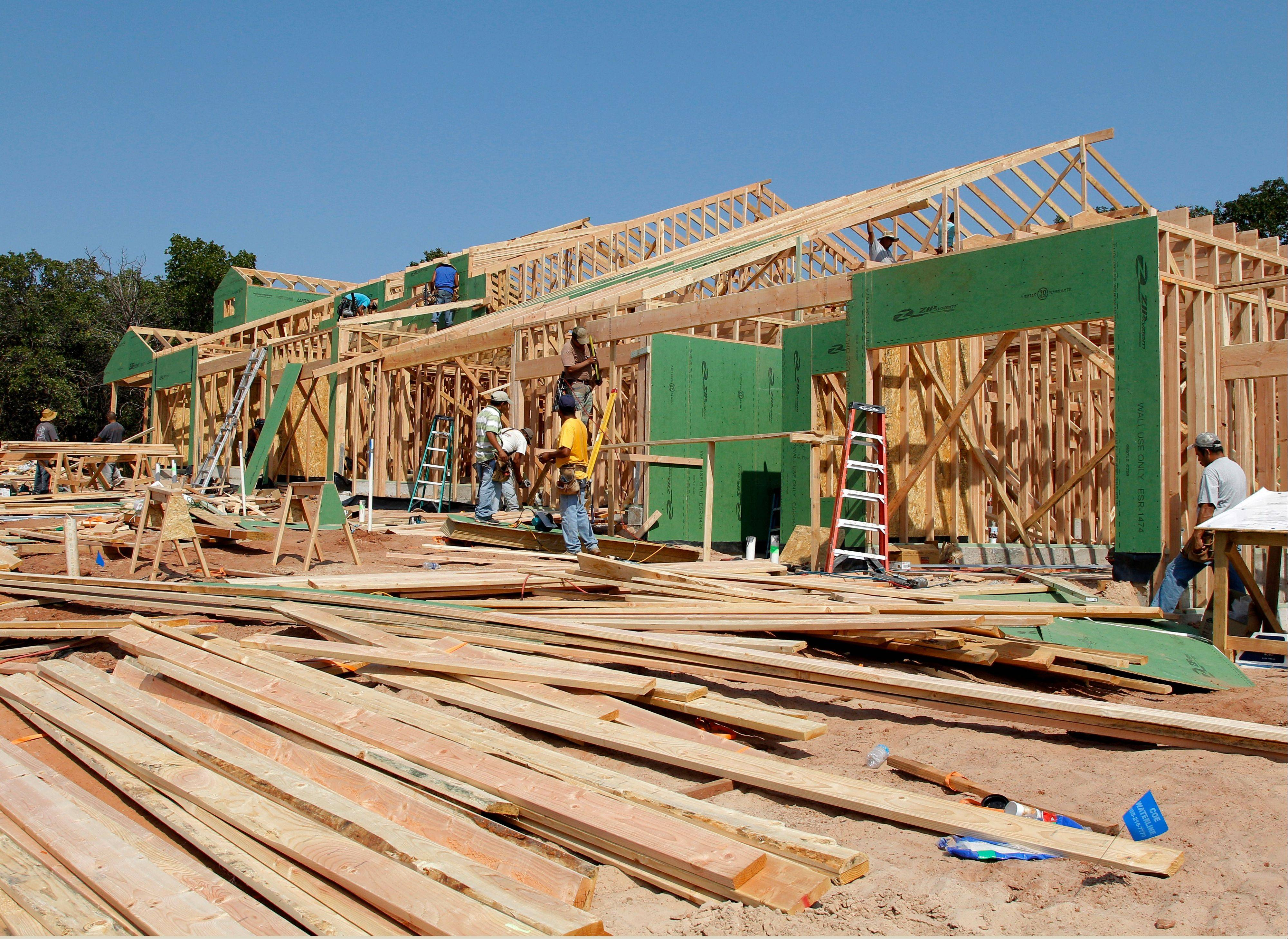 New homes are under construction in Edmond, Okla. Nearly all regions of the United States are reporting that stronger housing markets have helped boost economic growth since the middle of August, according to a survey relased Wednesday by the Federal Reserve. The Fed says growth improved in 10 of its 12 regional banking districts, while leveling off in one region and slowing in another. Rising home sales helped lift home prices.