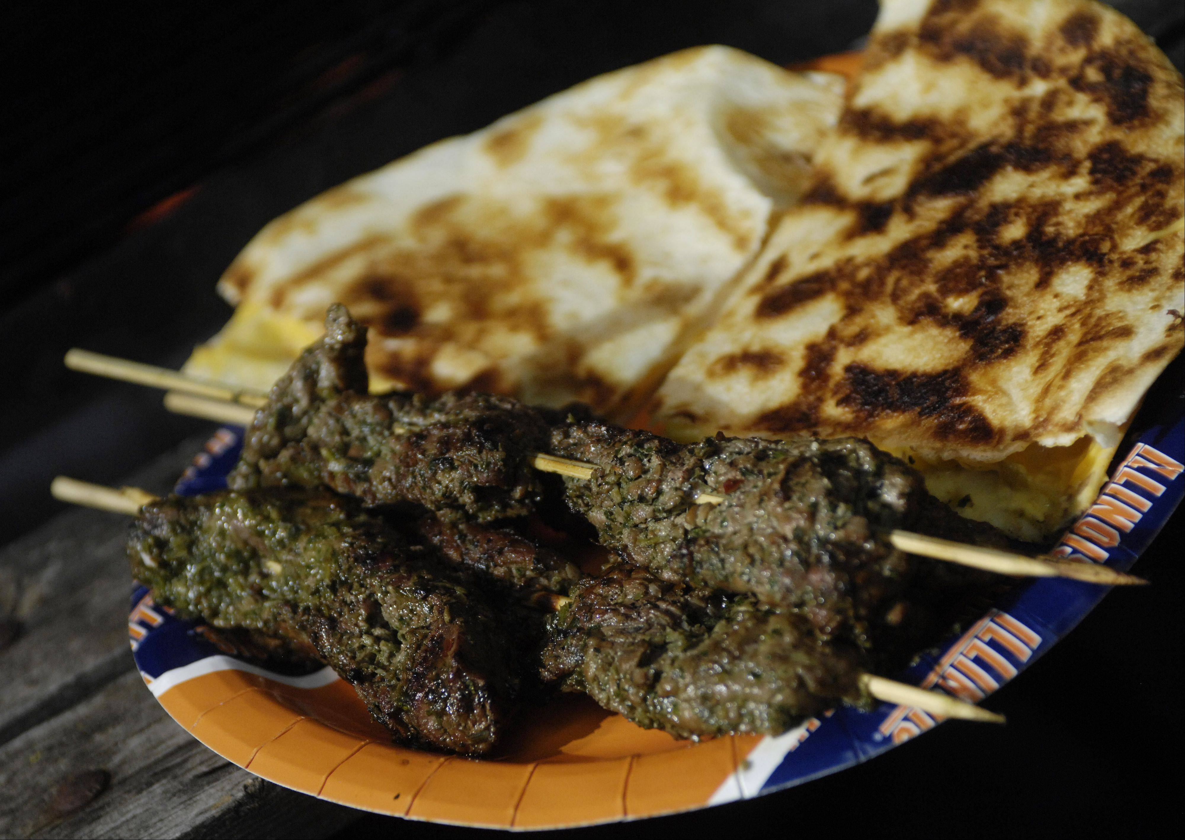 Michael Pennisi created a chimichurri-style sauce for beef skewers and serve the skewers with cumin-spiced quesadillas.