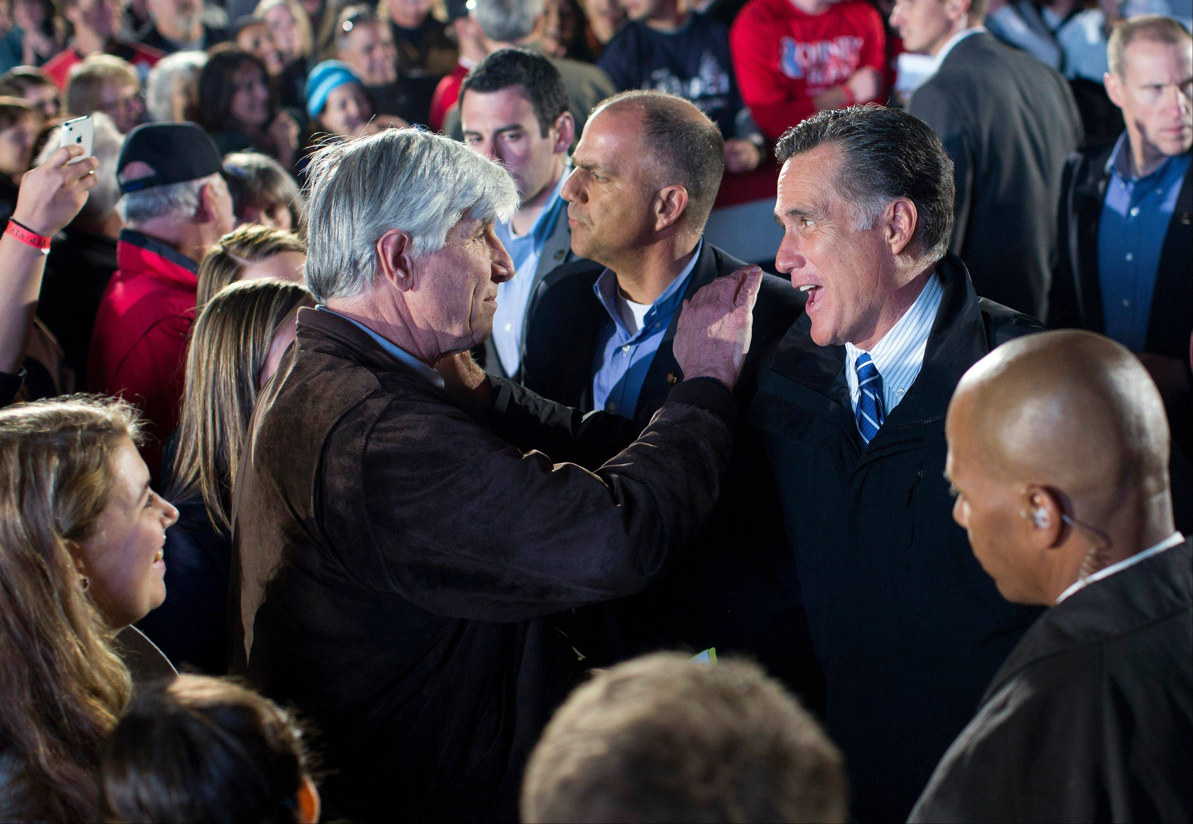 Republican presidential candidate, former Massachusetts Gov. Mitt Romney talks with supporters during a campaign stop on Tuesday, Oct. 9, 2012 in Cuyahoga Falls, Ohio.