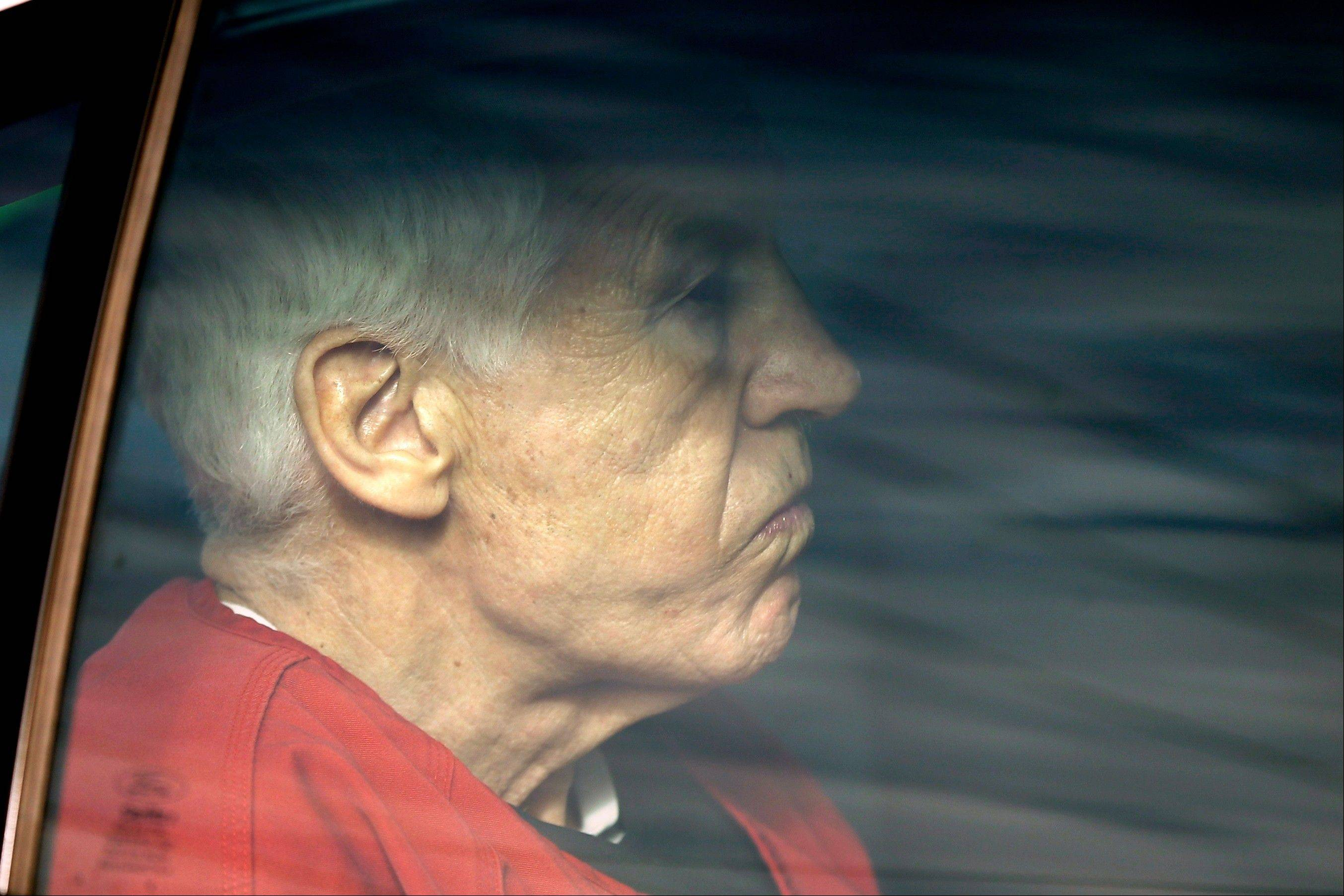 Former Penn State University assistant football coach Jerry Sandusky is driven from the Centre County Courthouse after being sentenced in Bellefonte, Pa., Tuesday, Oct. 9, 2012. Sandusky was sentenced to at least 30 years in prison, effectively a life sentence, in the child sexual abuse scandal that brought shame to Penn State and led to coach Joe Paterno's downfall.