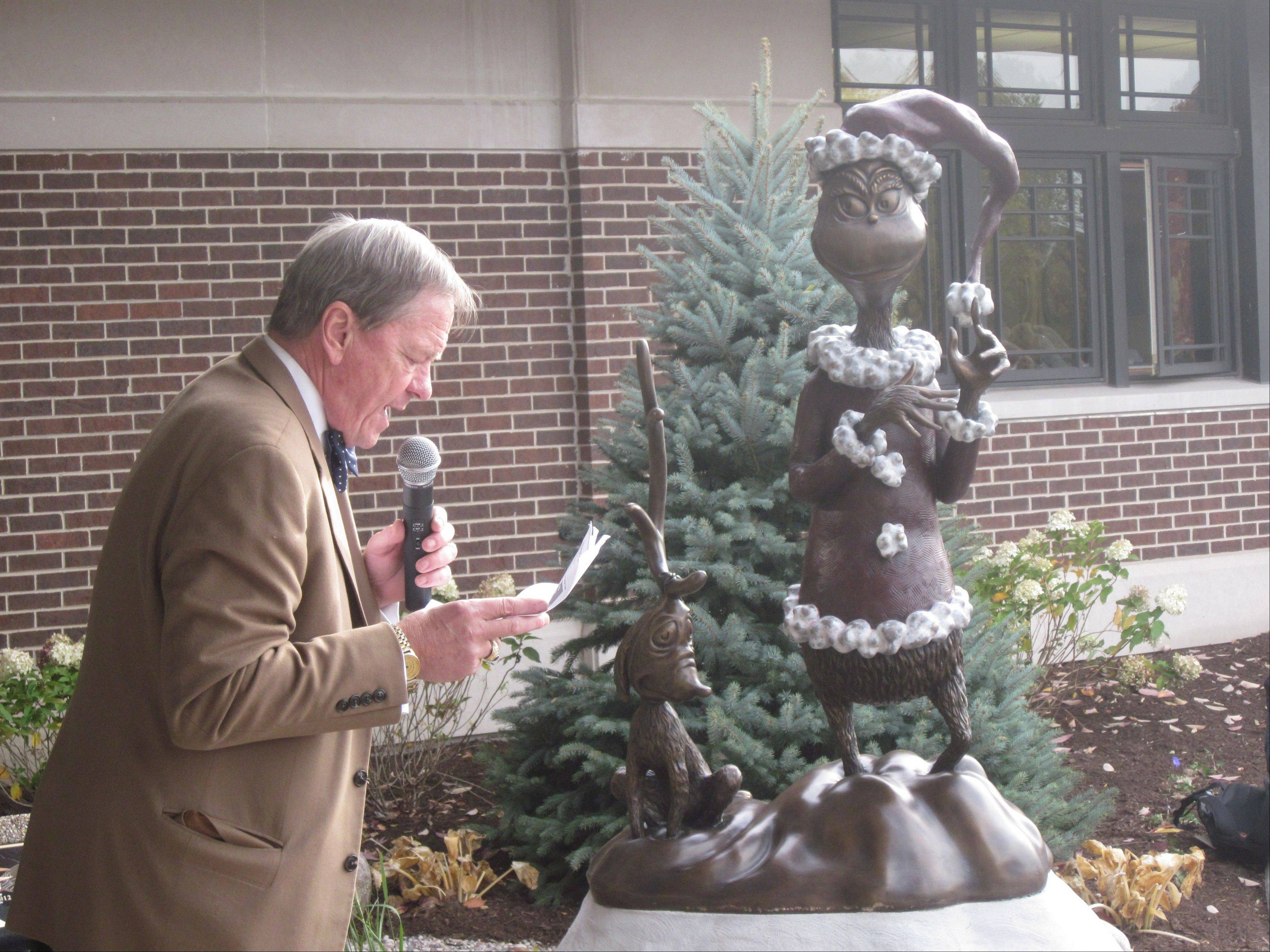 Century Walk Corp. President Brand Bobosky unveiled the new Grinch statue Tuesday at the Naper Boulevard Library.
