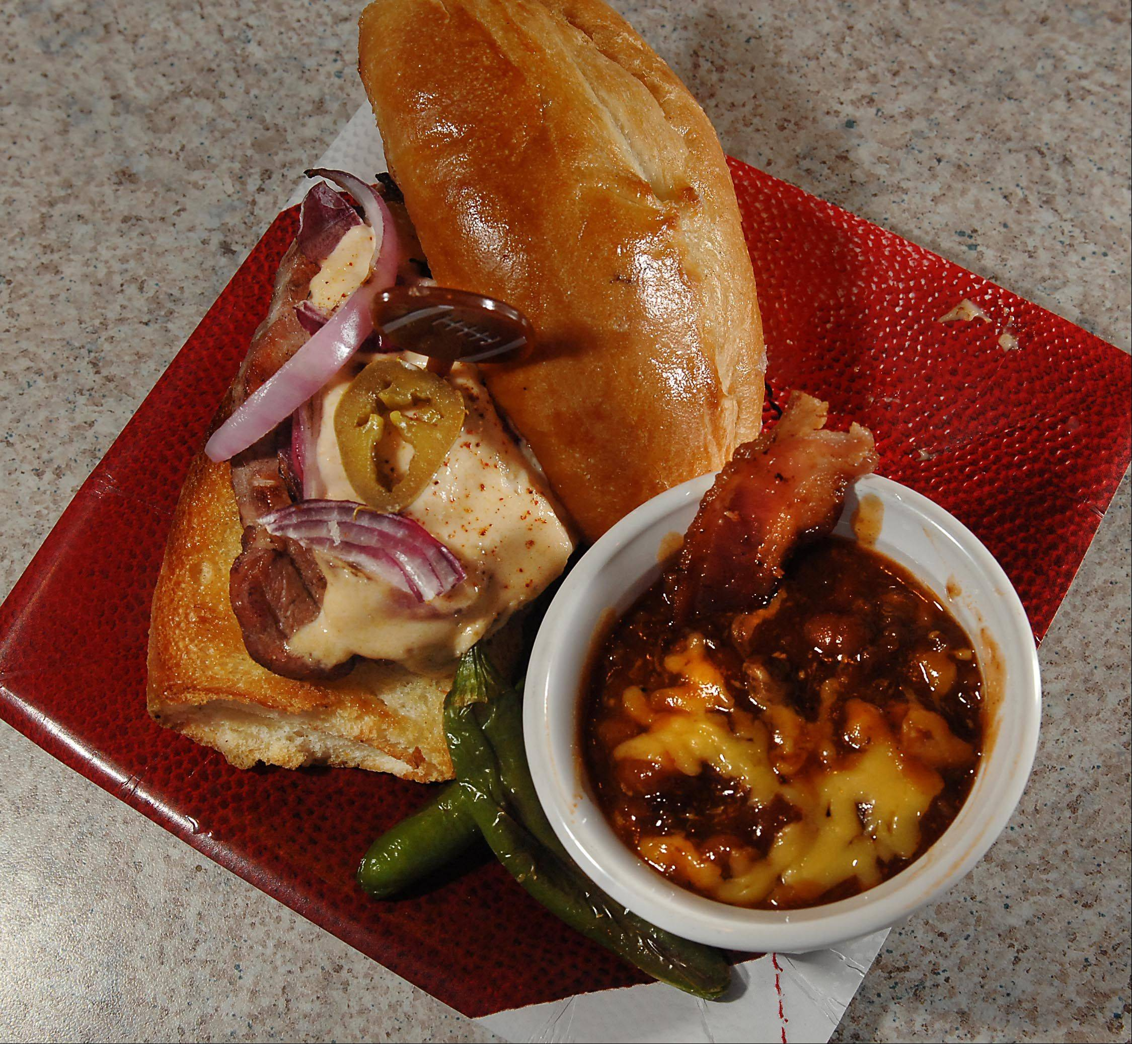 Mary Beth Thornton created an American-cheese sauce for grilled pork chop sandwiches. The pairs the sandwich with cumin- and Chianti-infused baked beans.