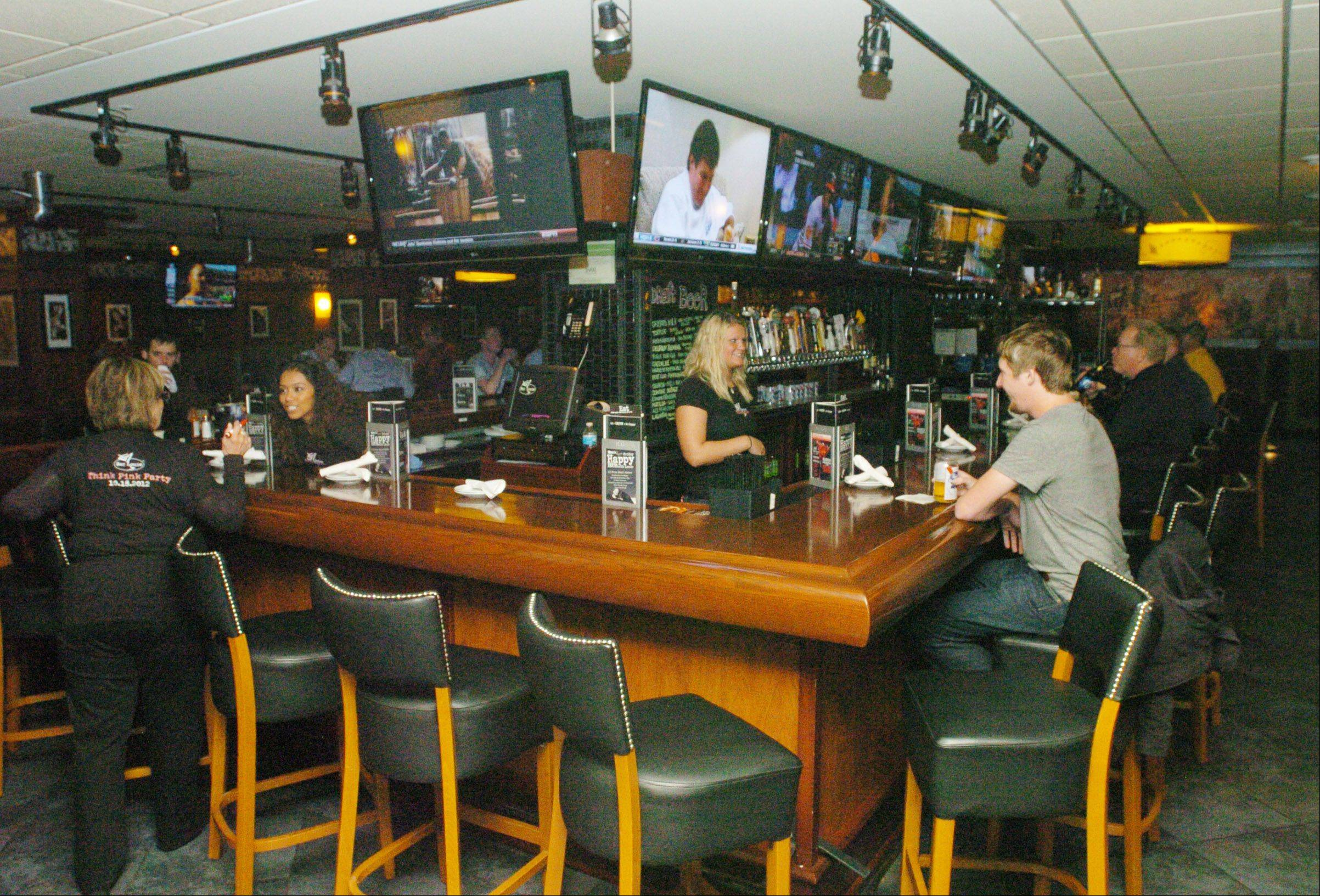 Guests can sip a cold beer or a martini while watching sports at Bar Louie.