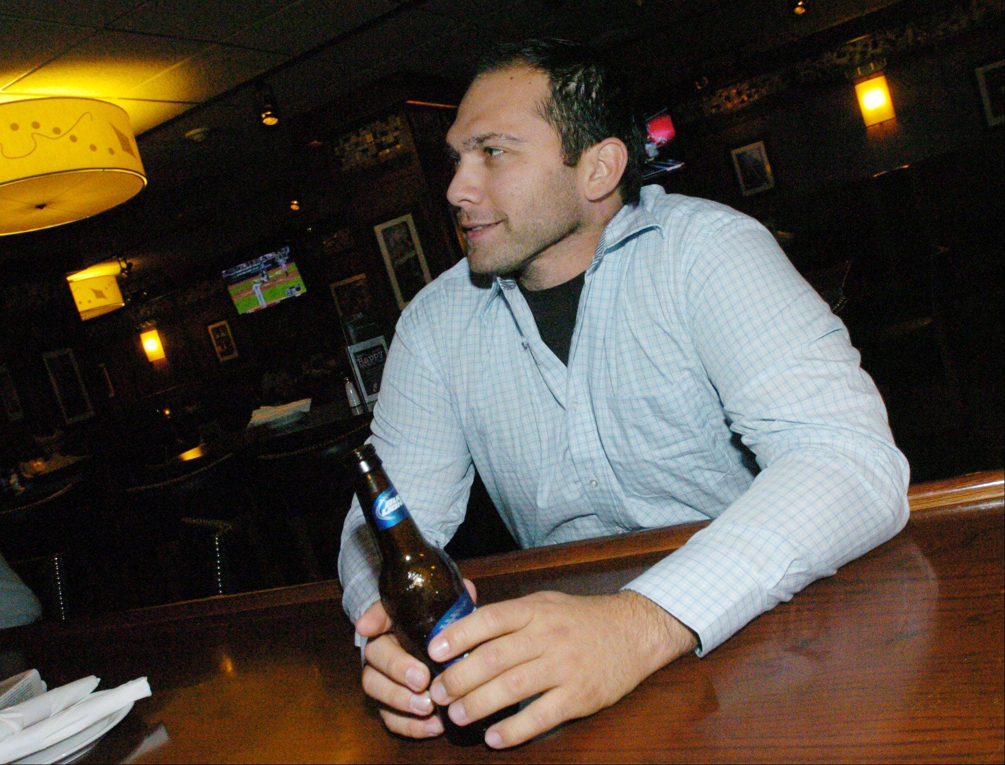 Joe Kasprzykof of Oak Lawn enjoys a cold beer at Bar Louie in Oakbrook Terrace.