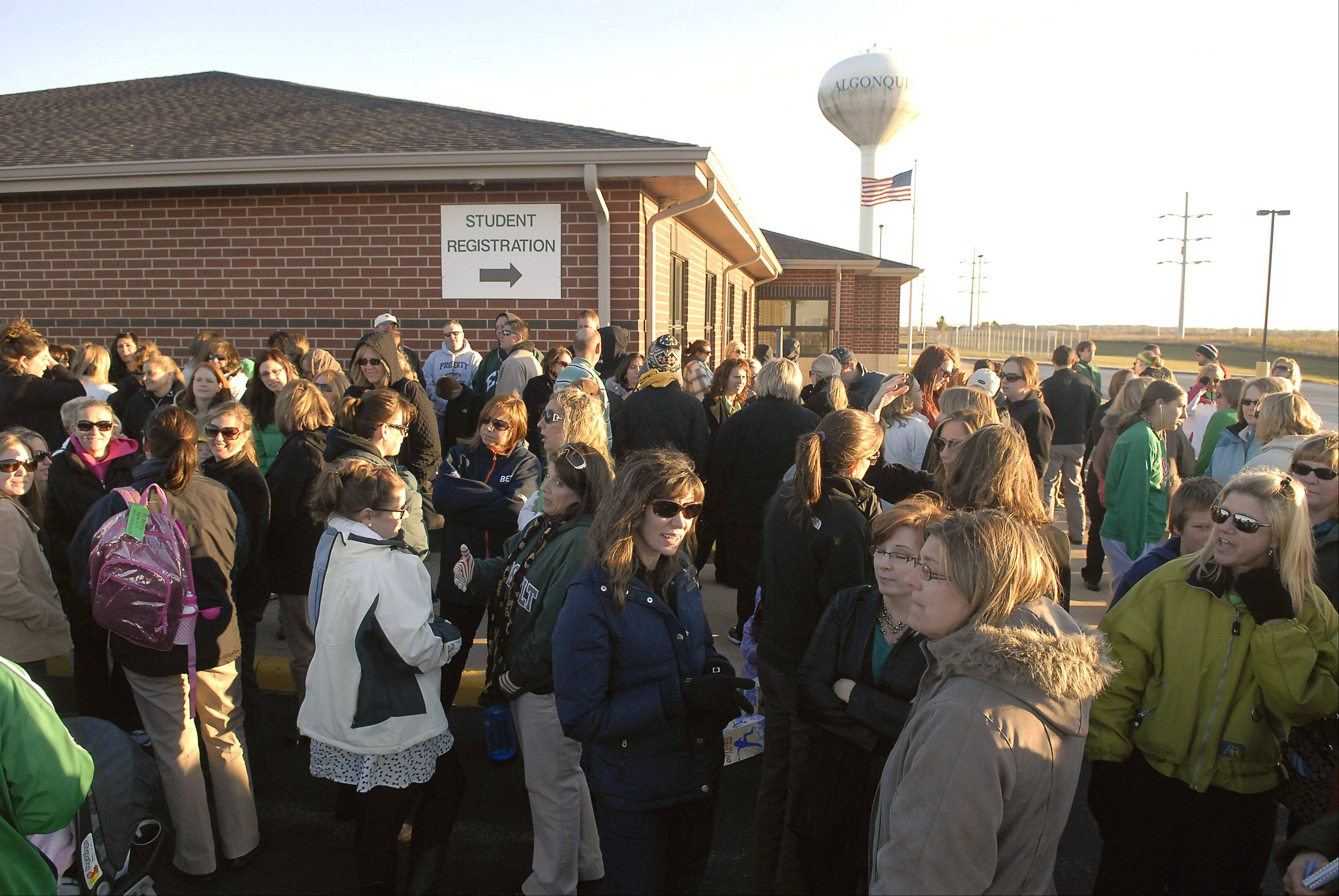 Huntley Unit District 158 teachers gather outside the district headquarters in Algonquin to show their solidarity before members of the Huntley Education Association meet with school board members to discuss the terms of their contract on Wednesday.