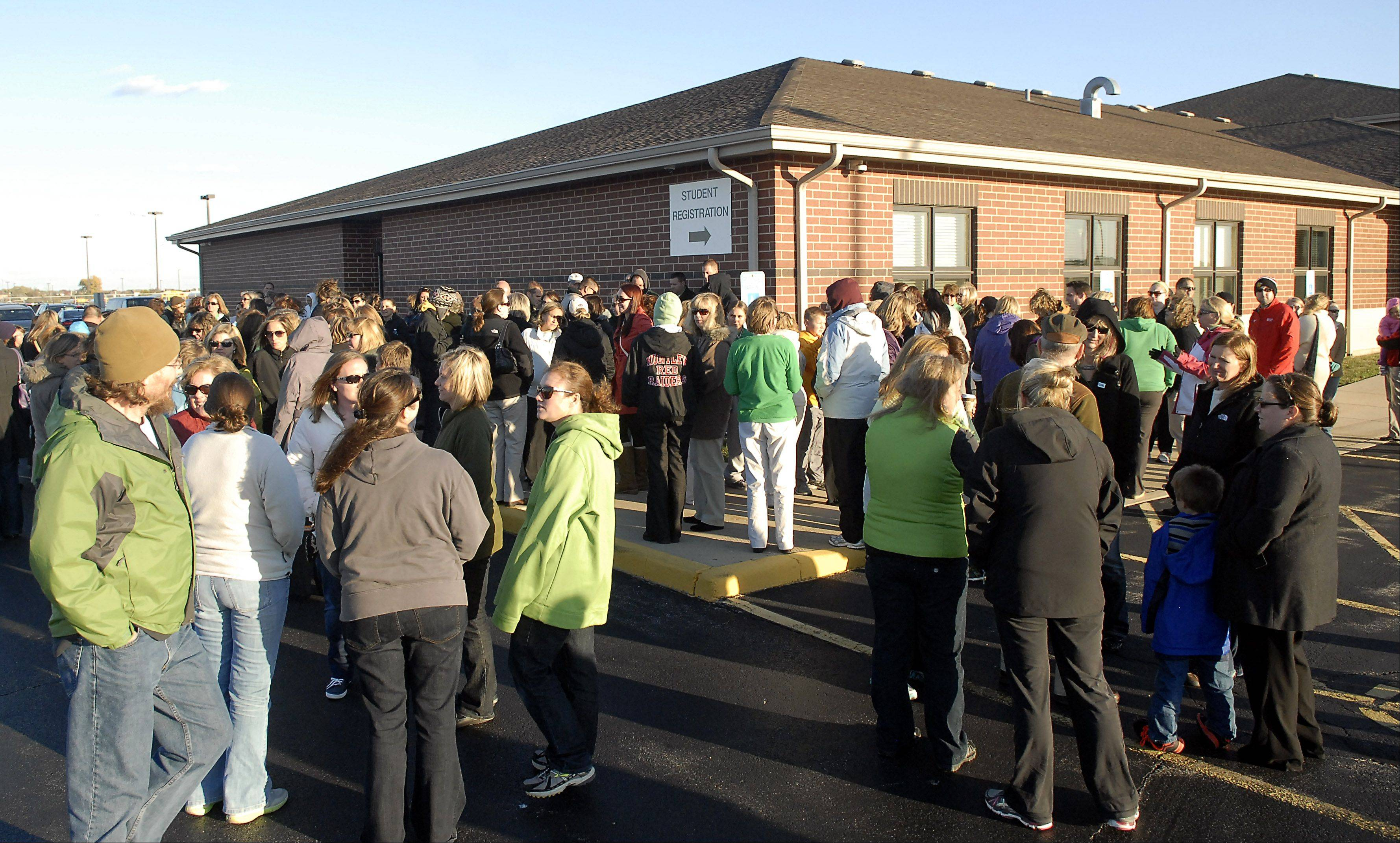 Huntley Unit District 158 teachers gather outside the district headquarters in Algonquin to show their solidarity before members of the Huntley Education Association met with school board members to discuss the terms of their contract on Wednesday.