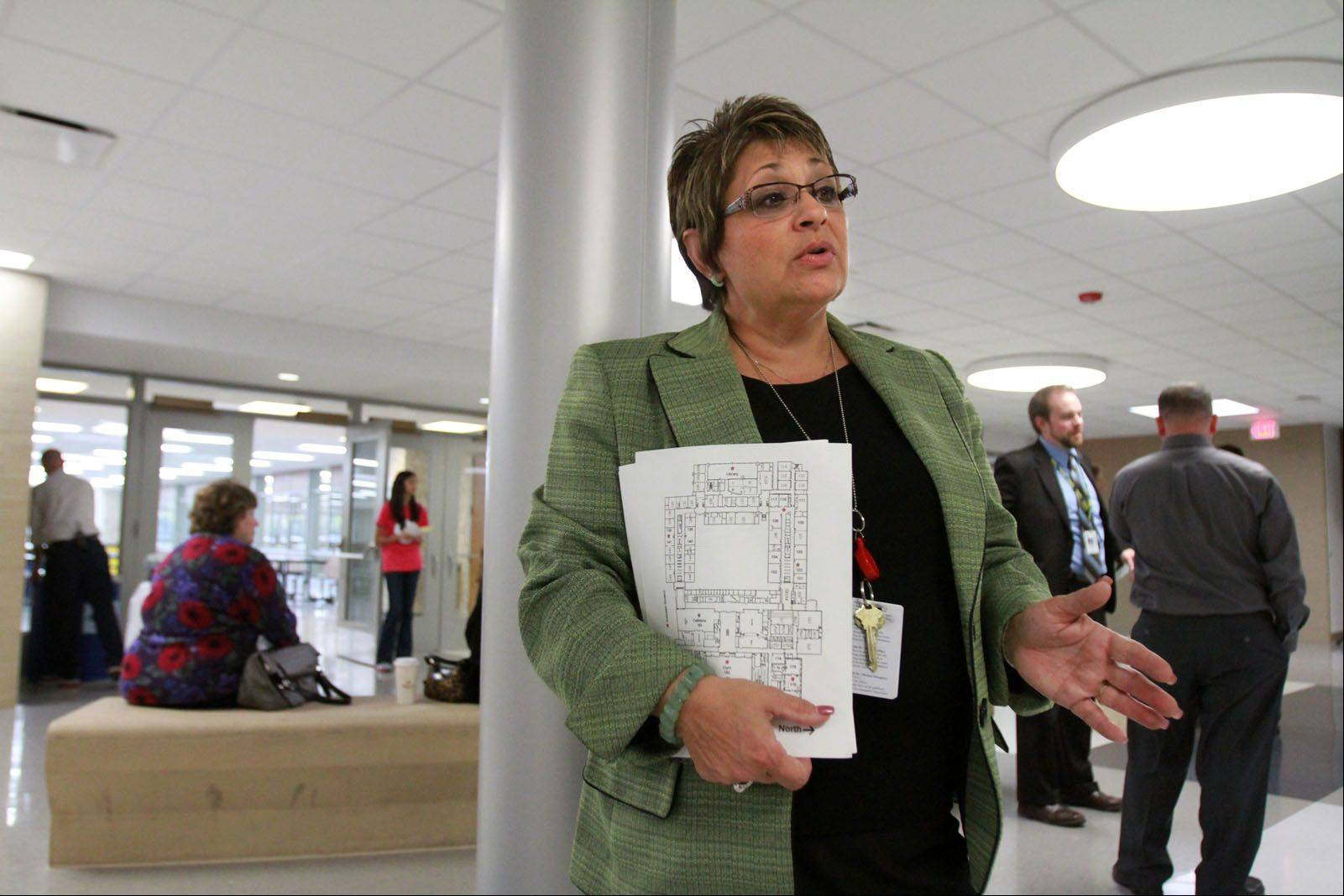 Debra Parenti, associate superintendent for finance and operations for District 214 talks about Elk Grove High School's sound-insulated ceiling Wednesday during tours of the school's multimillion dollar renovations that were finished in August.