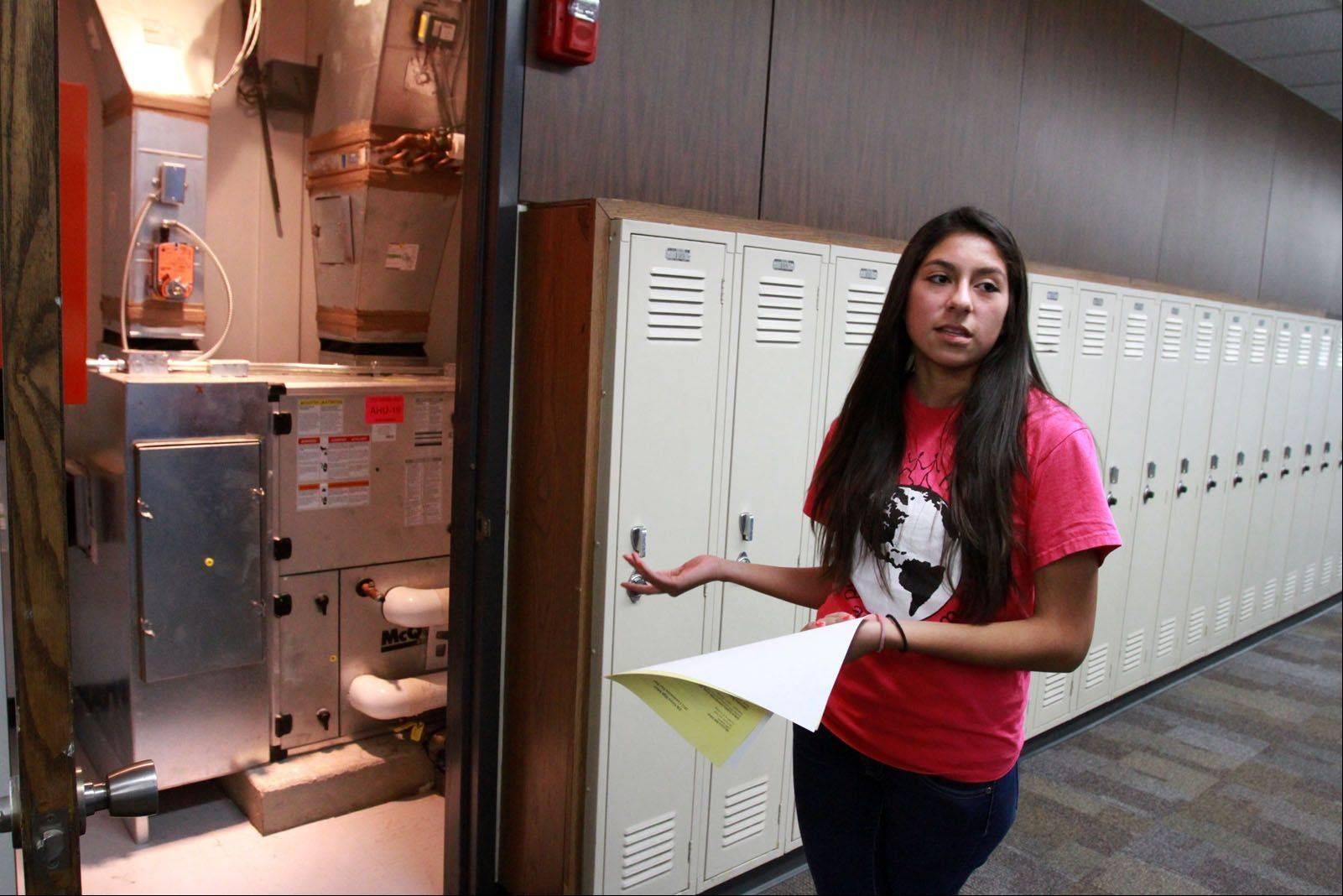Adriana Soliz, a student at Elk Grove High School, talks about part of the school's new cooling system Wednesday during a tour of the school's multimillion dollar renovation project. The project was completed in August.