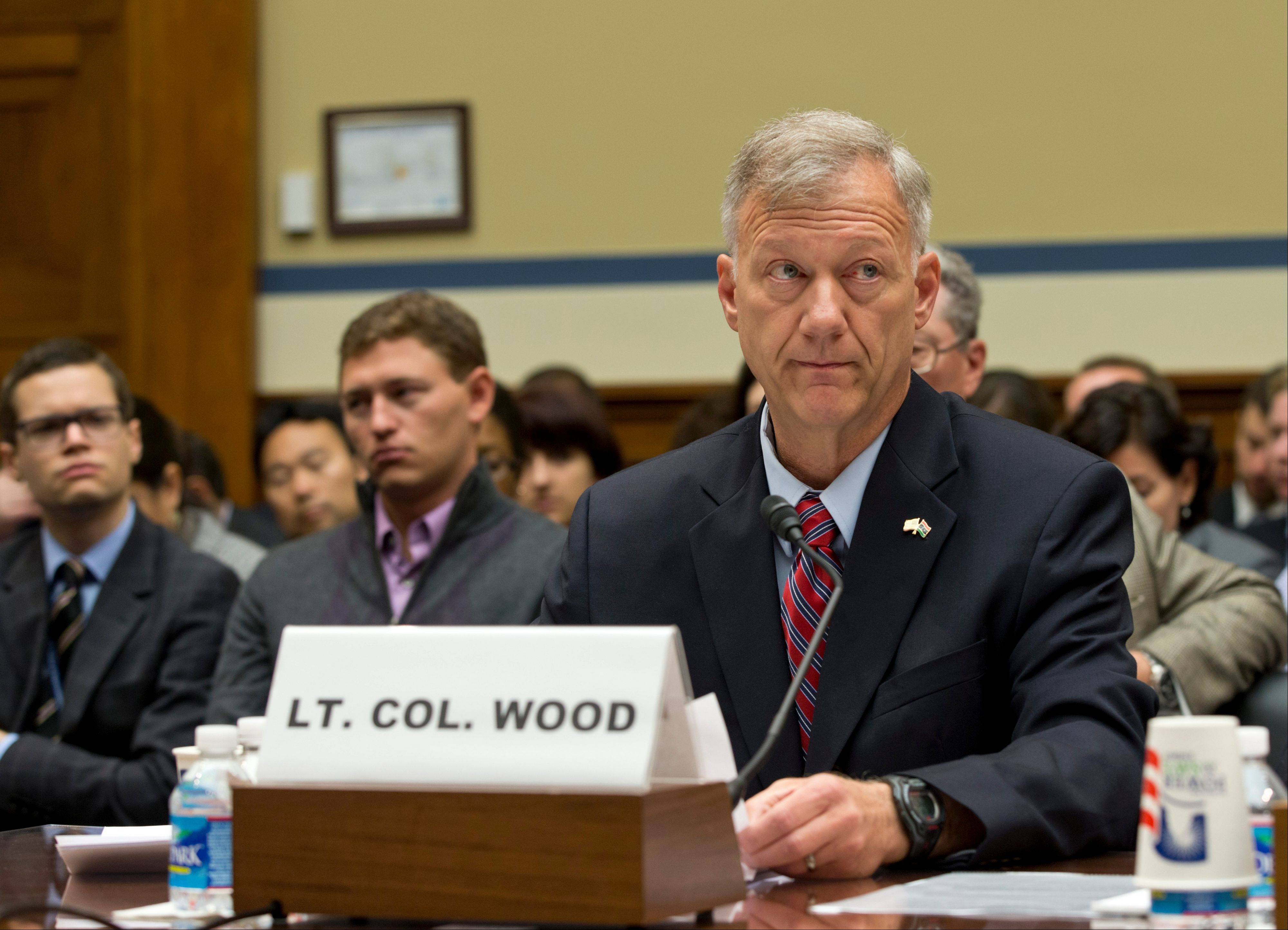 Lt. Col. Andrew Wood, a Utah National Guard Army Green Beret who was the top security official at the consulate in Libya, testifies Wednesday on Capitol Hill in Washington before the House Oversight and Government Reform Committee hearing investigating the Sept. 11, 2012 attack on the American consulate in Benghazi, Libya, that resulted in the death of U.S. Ambassador Christopher Stevens and other Americans.