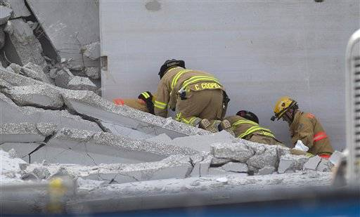 Rescue workers have freed a construction worker trapped in the rubble for about 12 hours after a parking garage collapsed at a Florida college. He was brought to a hospital, but his condition was not immediately known.