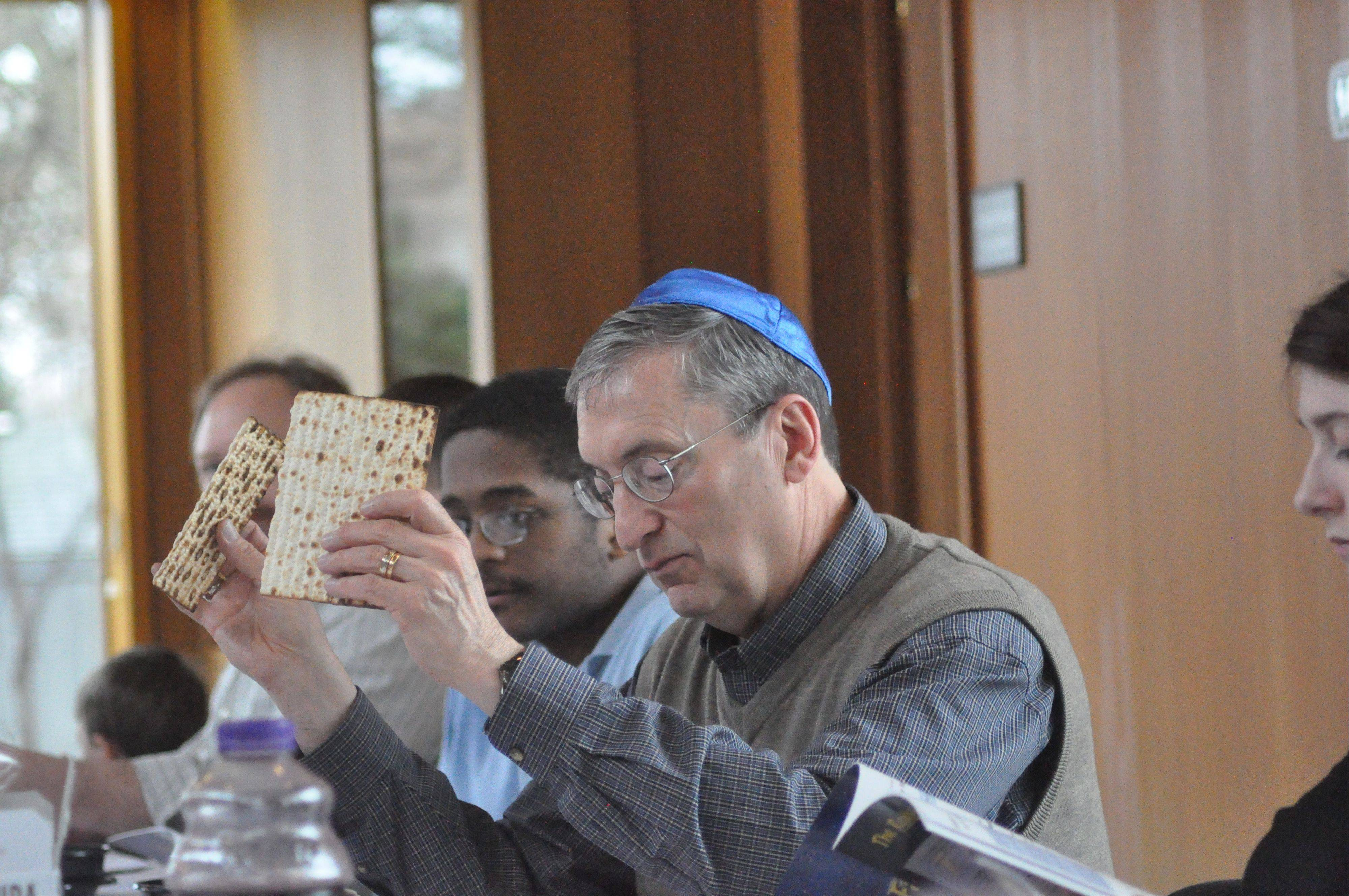 Aurora University often holds religious gatherings, such as this Passover Seder in 2011, at the Wackerlin Center for Faith and Action, which will be expanded under an addition plan approved this week by the Aurora City Council.