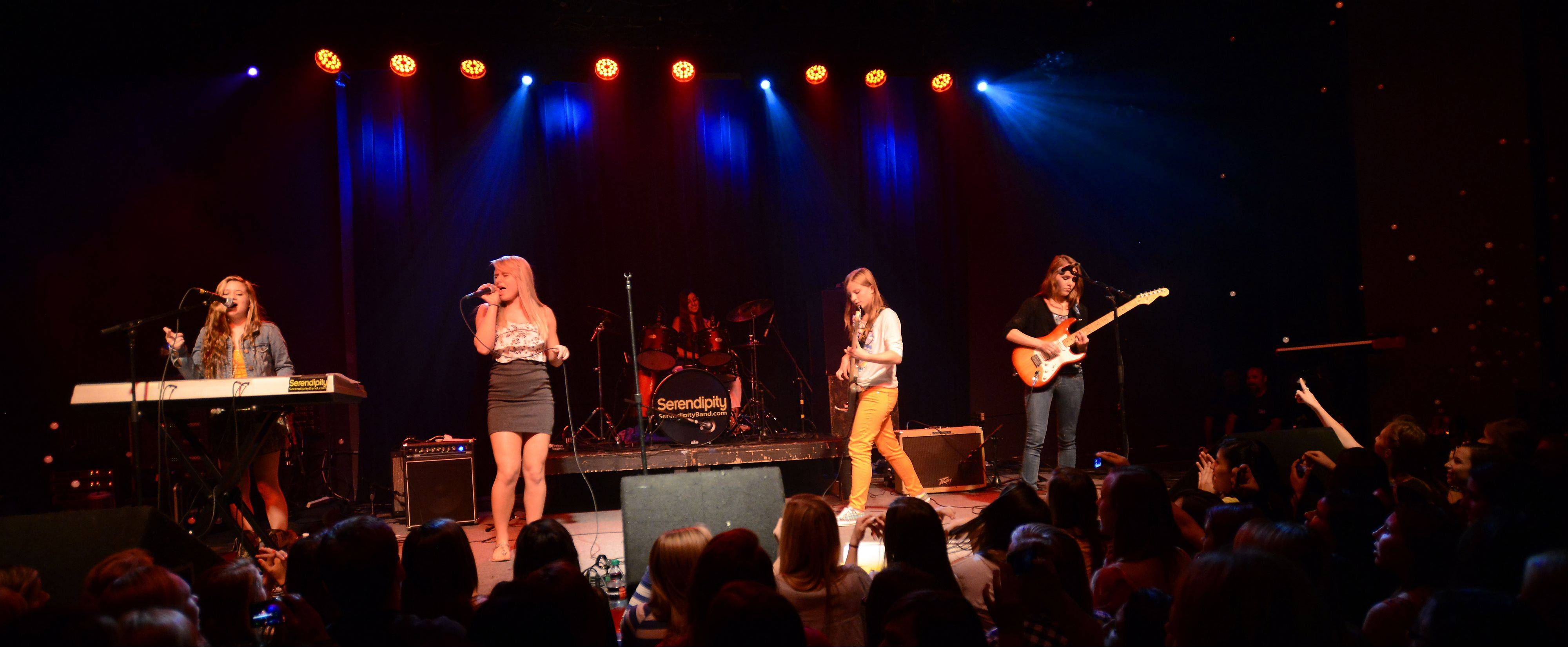 Serendipity band members Josie Treffy, 15, of South Elgin, Haley Blomquist, 15, of Elk Grove Village, Daniella Ballarino, 16, of Mount Prospect, and Anneliese Schulz, 15, of Elk Grove Village, with Lizzy Petitt, 15, of Arlington Heights play for their fans at Durty Nellie's in Palatine.
